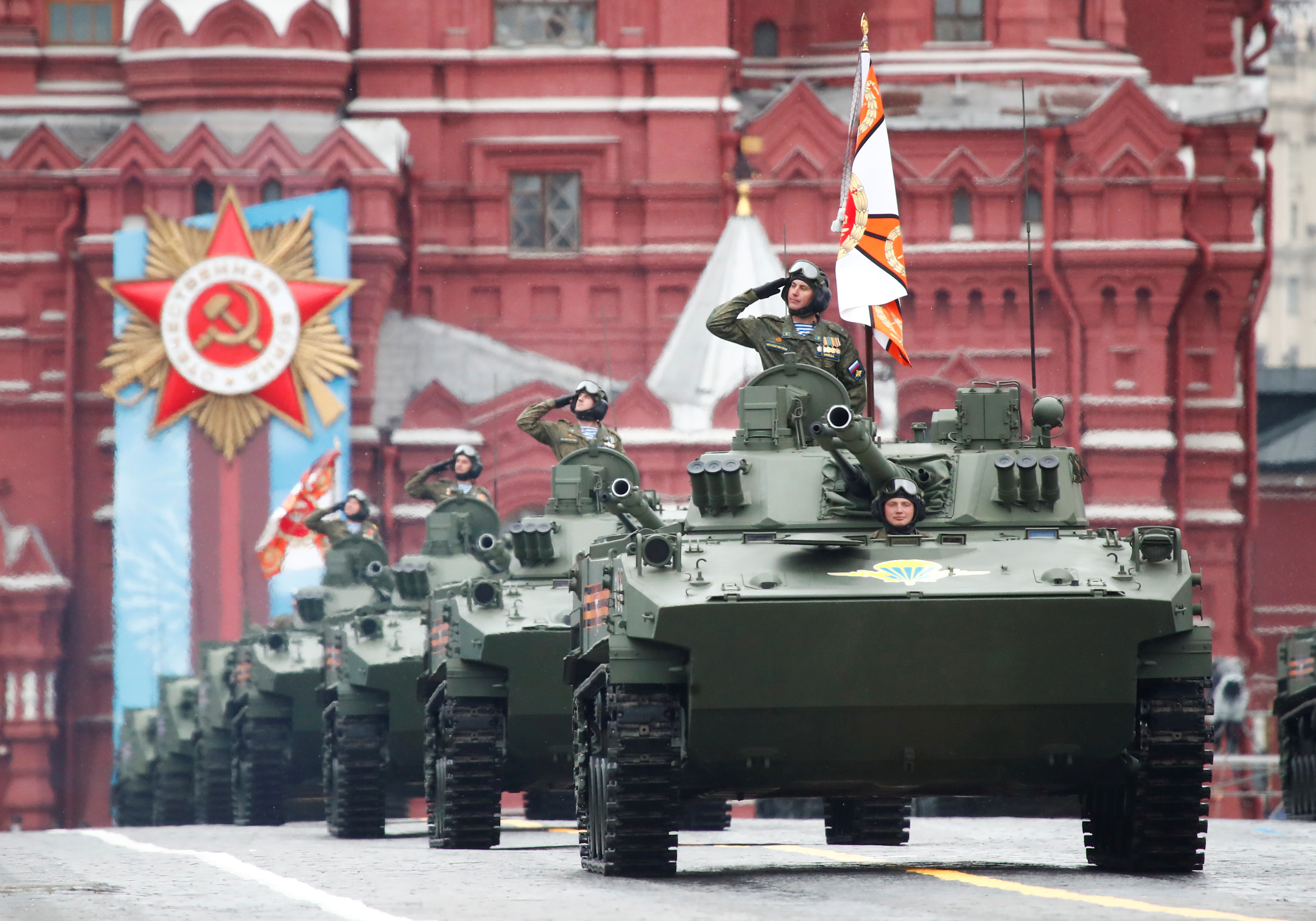 Russian service members drive BMD-4M infantry fighting vehicles during a military parade on Victory Day, which marks the 76th anniversary of the victory over Nazi Germany in World War Two, in Red Square in central Moscow, Russia May 9, 2021. REUTERS/Maxim Shemetov