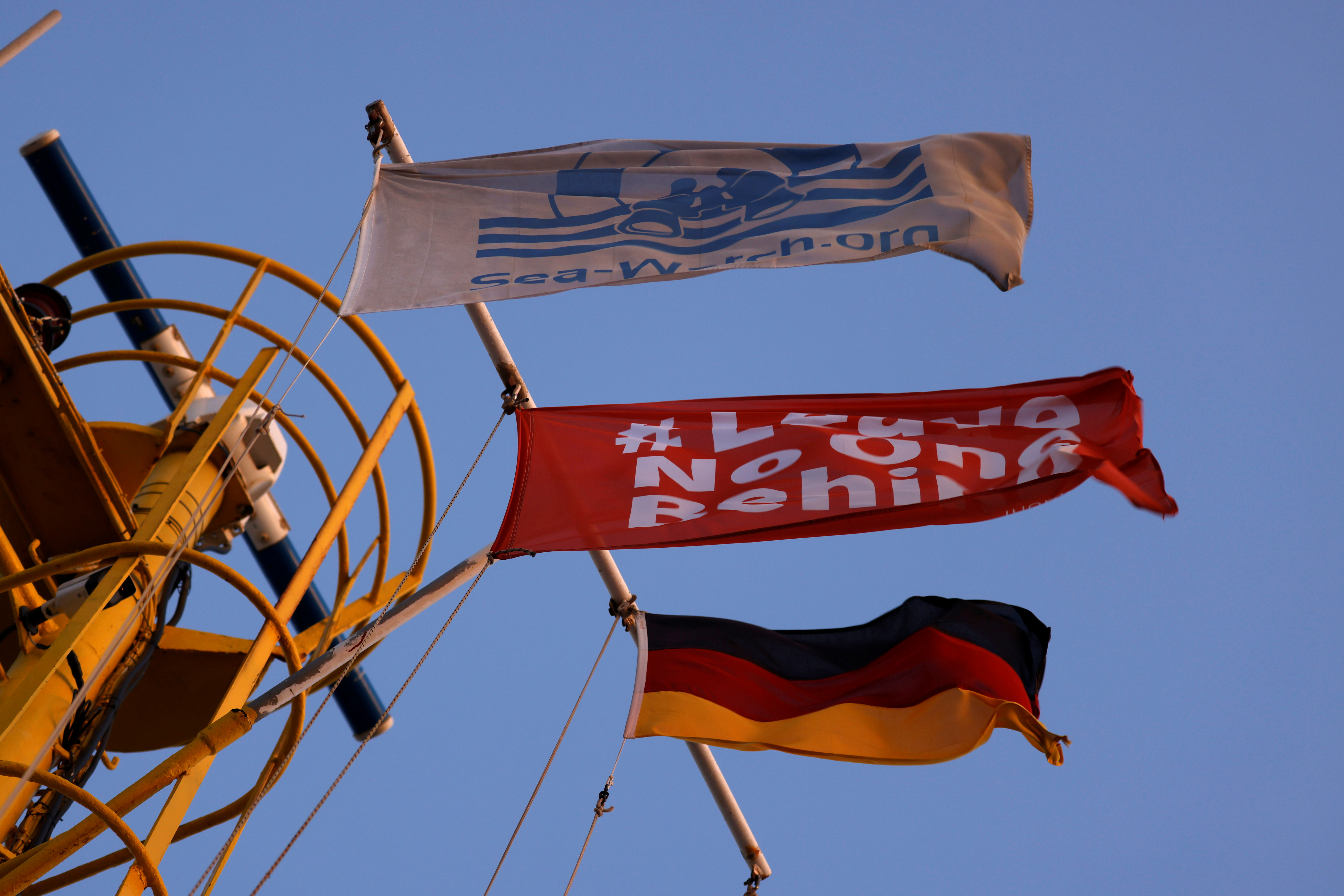 A flag of the German NGO Sea-Watch, a flag reading