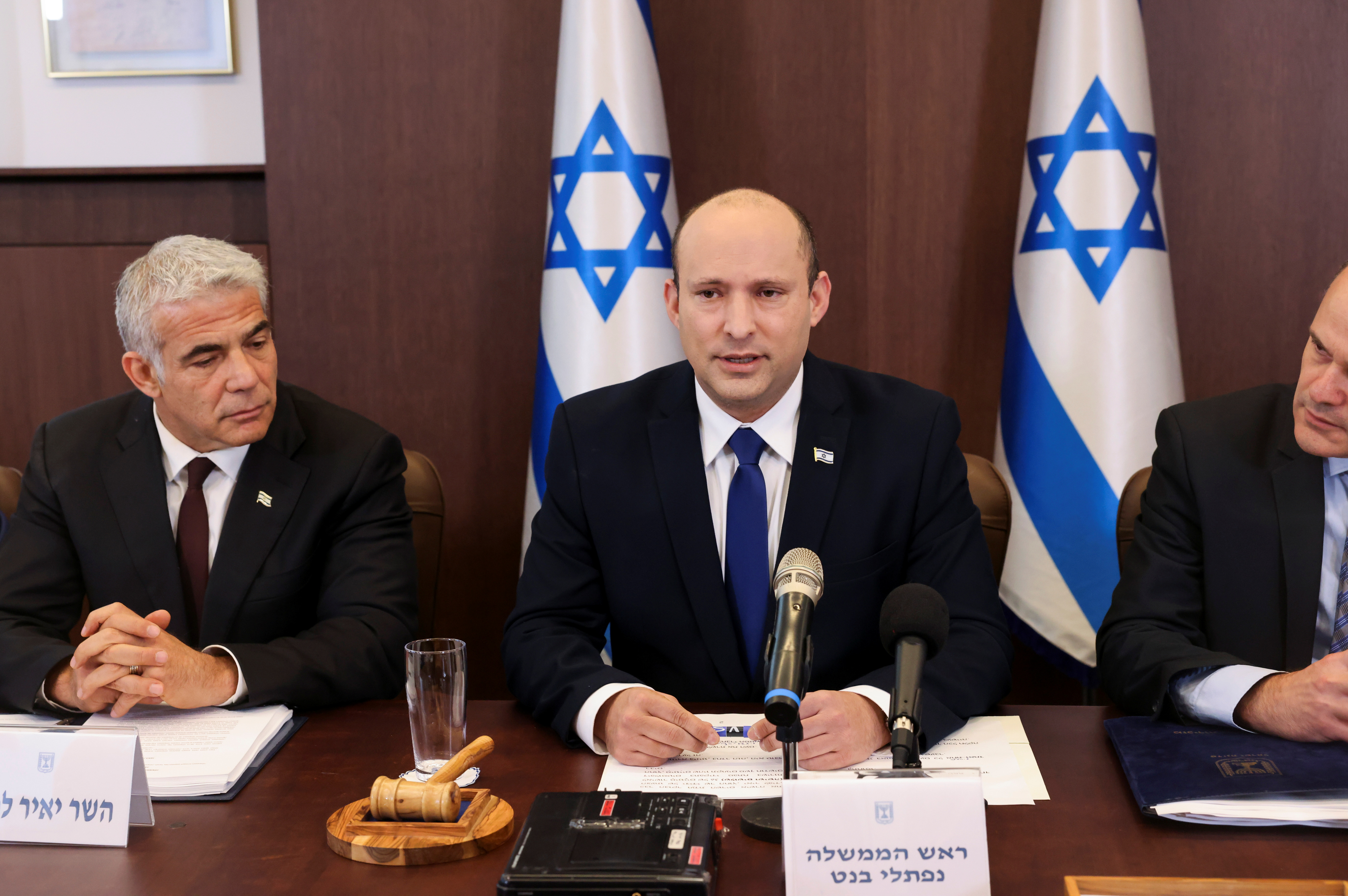 Israeli Prime Minister Naftali Bennett chairs the first weekly cabinet meeting of his new government in Jerusalem June 20, 2021. Emmanuel Dunand/Pool via REUTERS