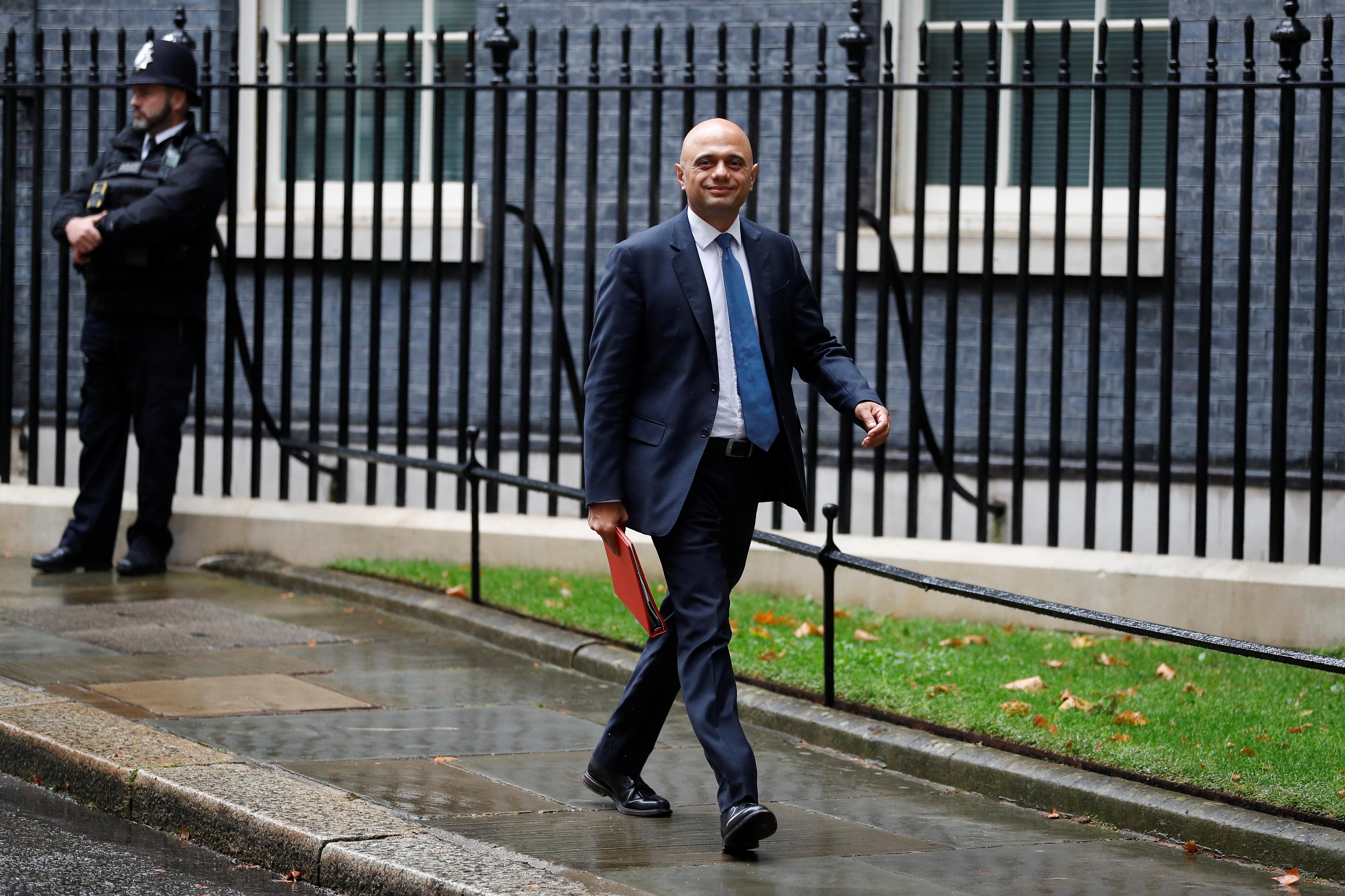 Britain's Health Secretary Sajid Javid walks outside Downing Street in London, Britain, September 14, 2021. REUTERS/Peter Nicholls