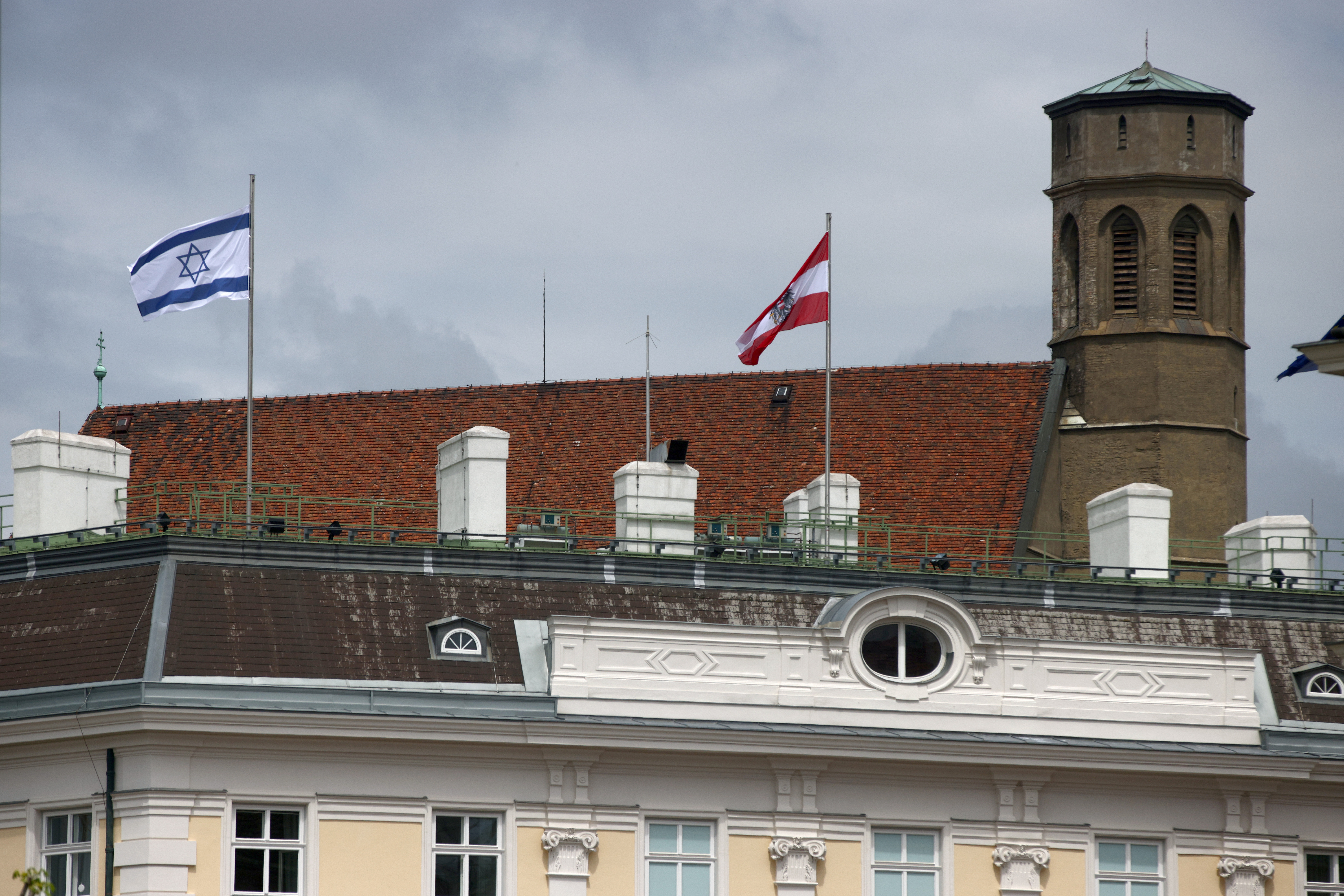 The national flag of Israel is seen atop the federal chancellery in Vienna, Austria May 15, 2021. REUTERS/Lisi Niesner