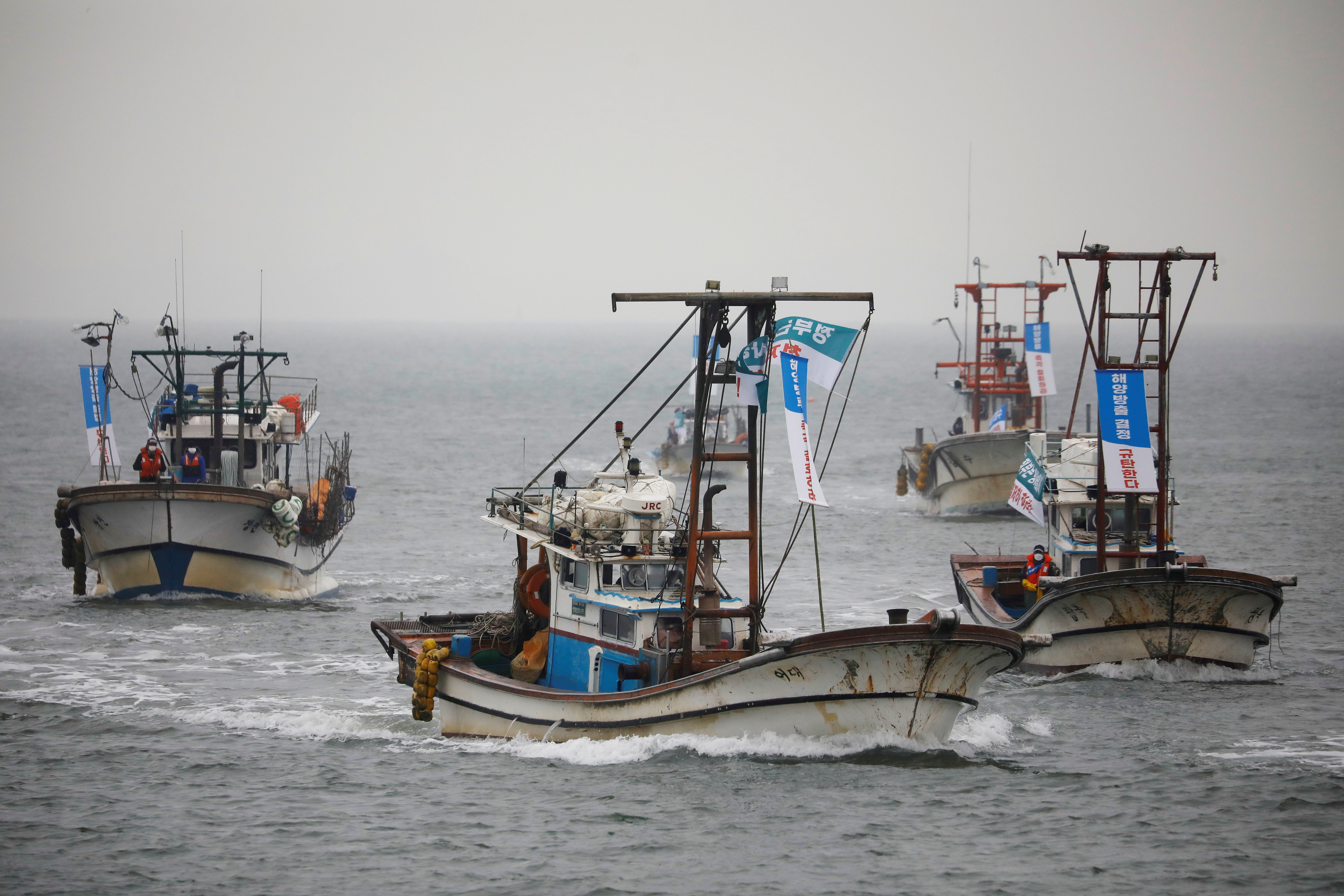 South Korean fishing boats take part in a marine protest, part of nationwide protests to demand Japan withdraw its decision to release contaminated water from its crippled Fukushima nuclear plant into the sea, at the sea off Incheon, South Korea, April 30, 2021.  REUTERS/Kim Hong-Ji/File Photo