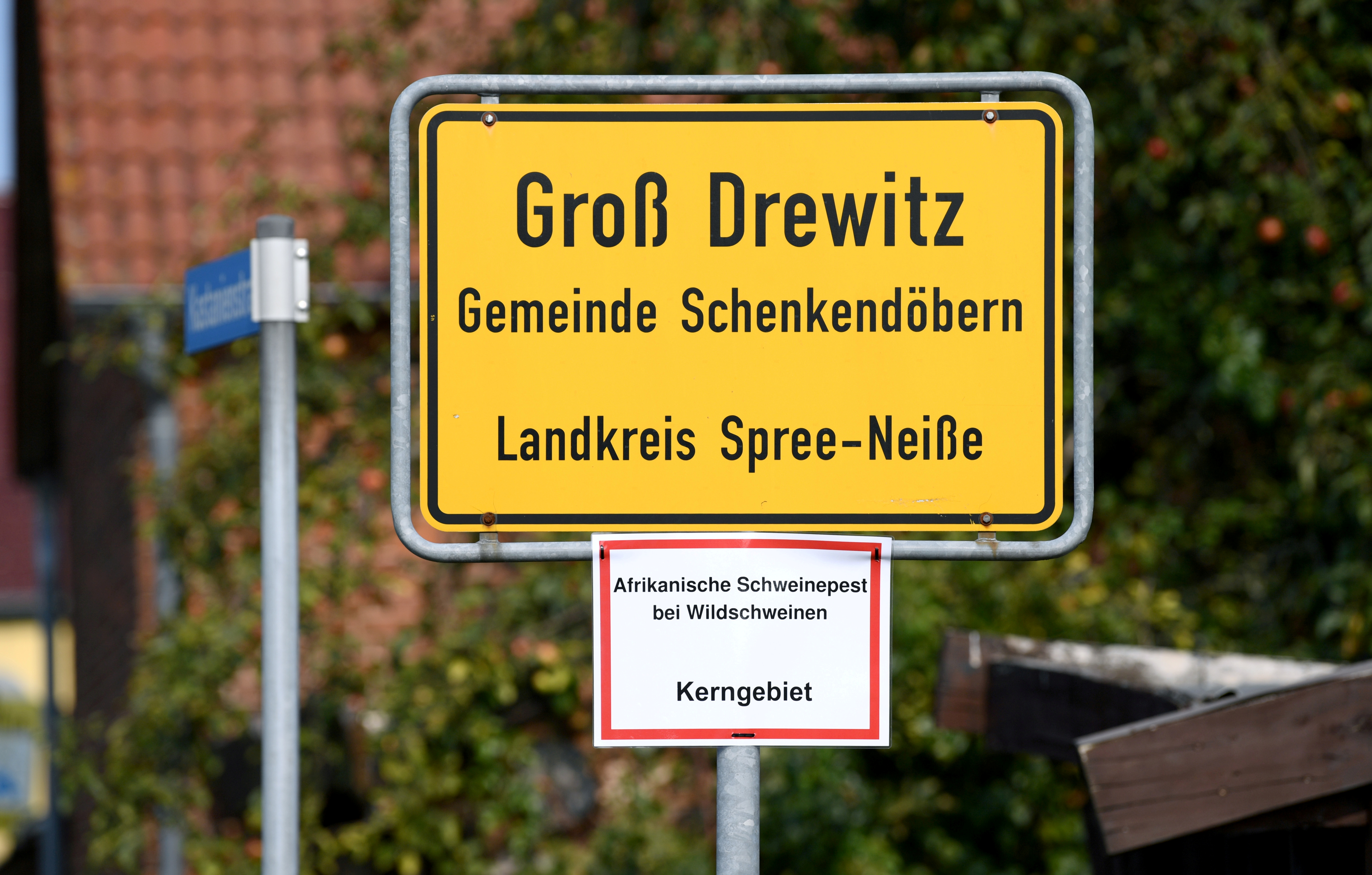 The town sign of Gross Drewitz is seen with a note reading