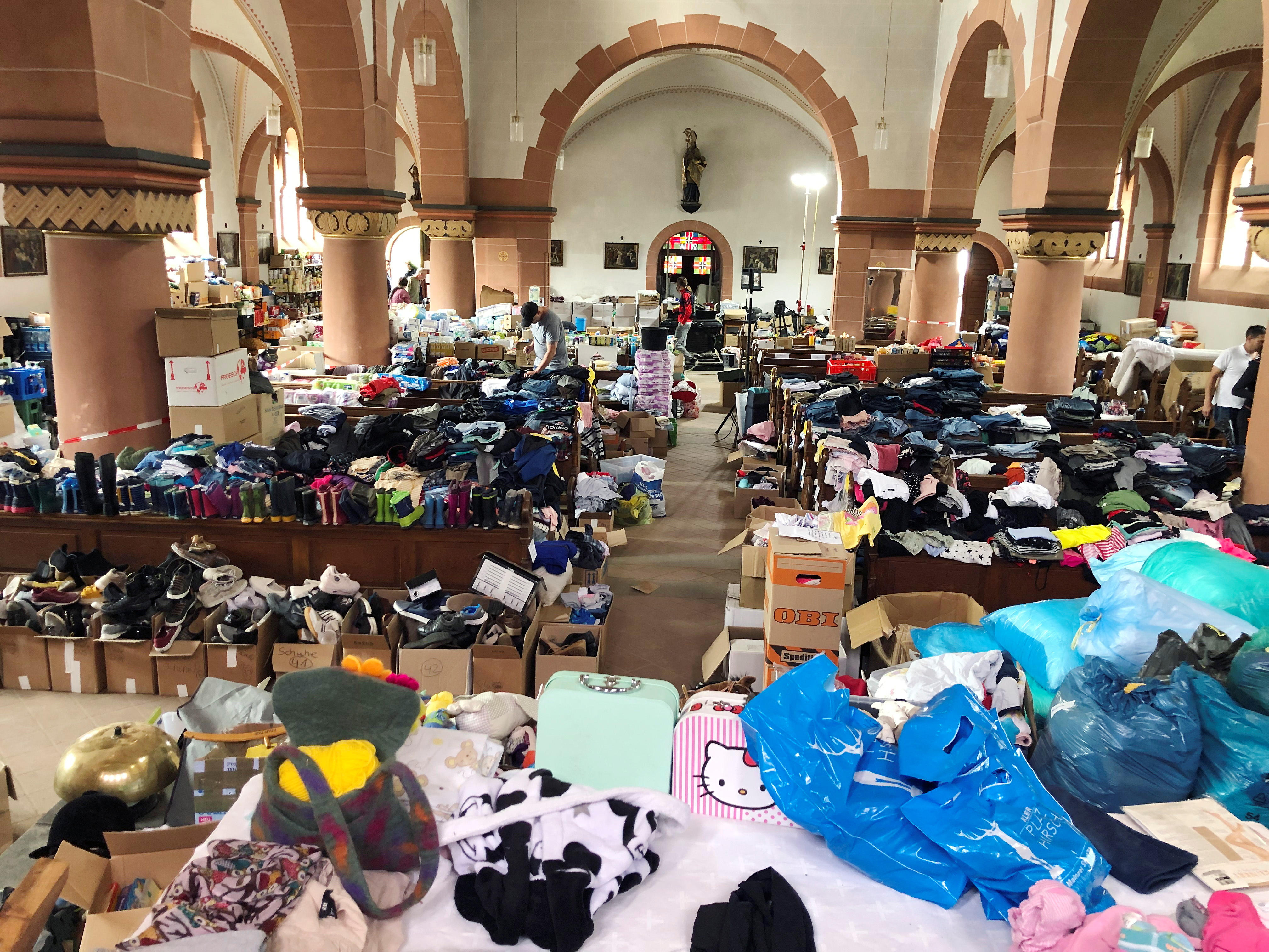 Donations for flood victims lie in the church of St. Nicholas and Rochus in Mayschoss, Germany, July 29, 2021. REUTERS/Andreas Kranz