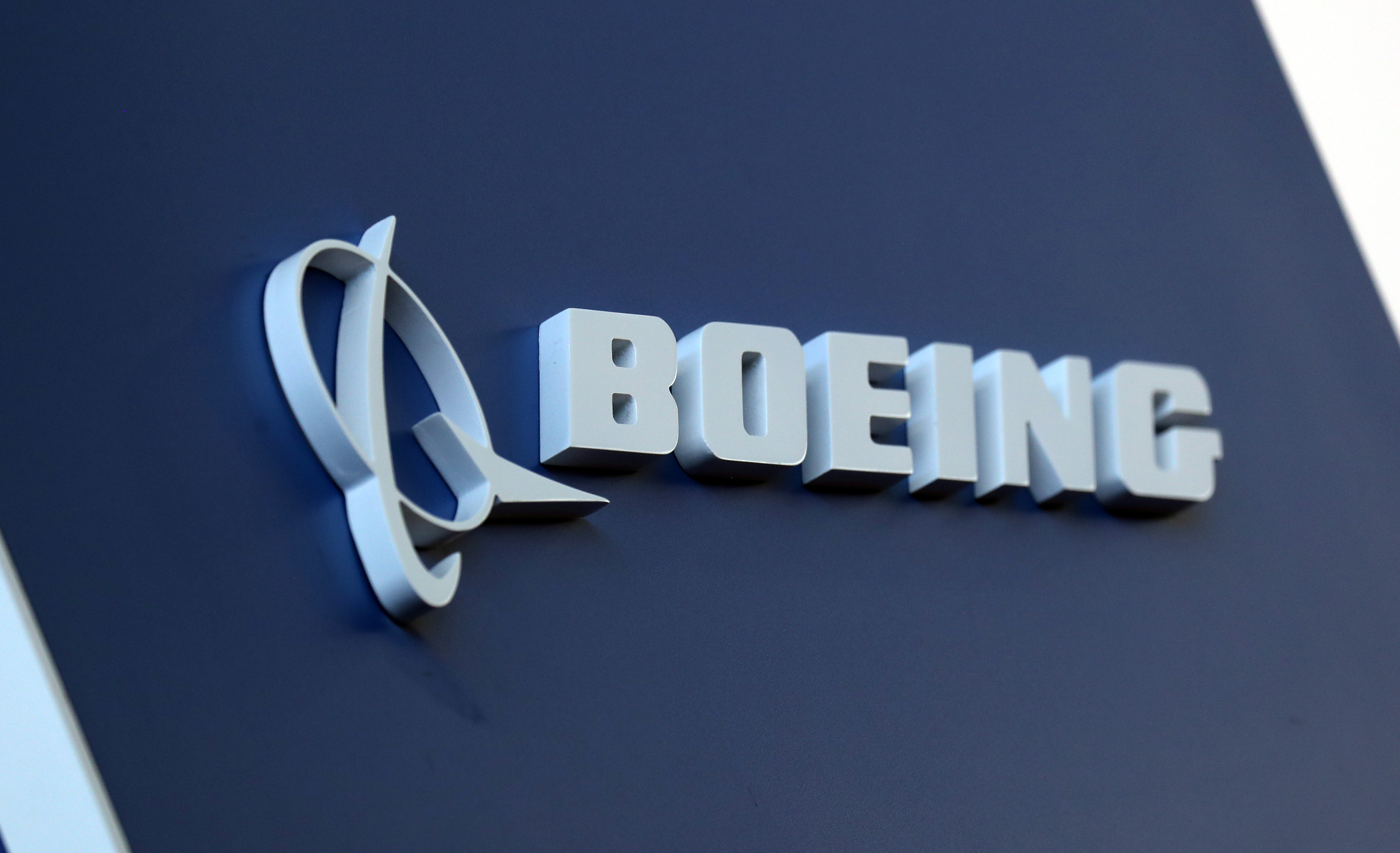 The Boeing logo is pictured at the Latin American Business Aviation Conference & Exhibition fair (LABACE) at Congonhas Airport in Sao Paulo, Brazil August 14, 2018. REUTERS/Paulo Whitaker