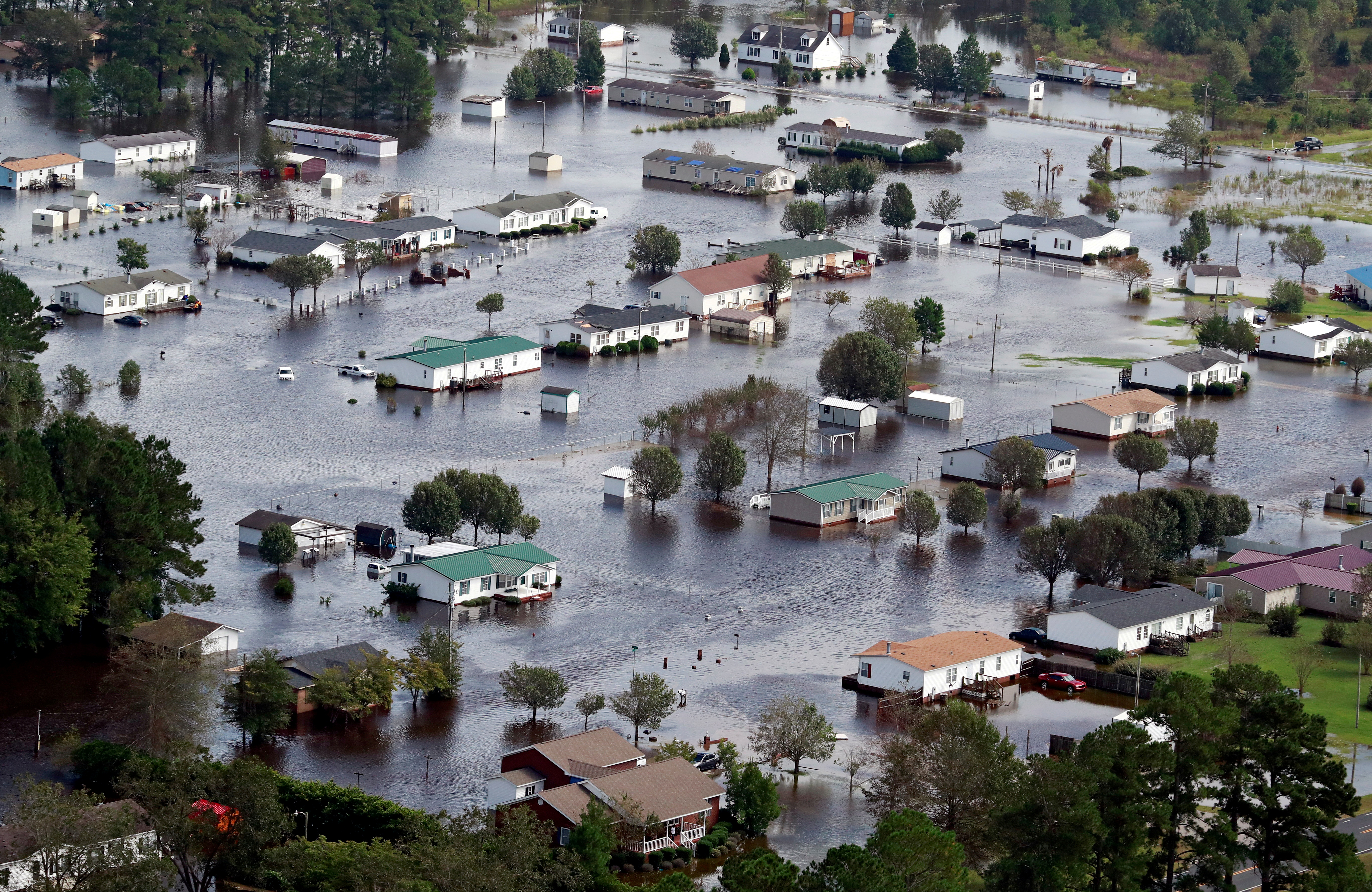 Houses sit in floodwater caused by Hurricane Florence, in this aerial picture, on the outskirts of Lumberton, North Carolina, U.S. September 17, 2018. REUTERS/Jason Miczek