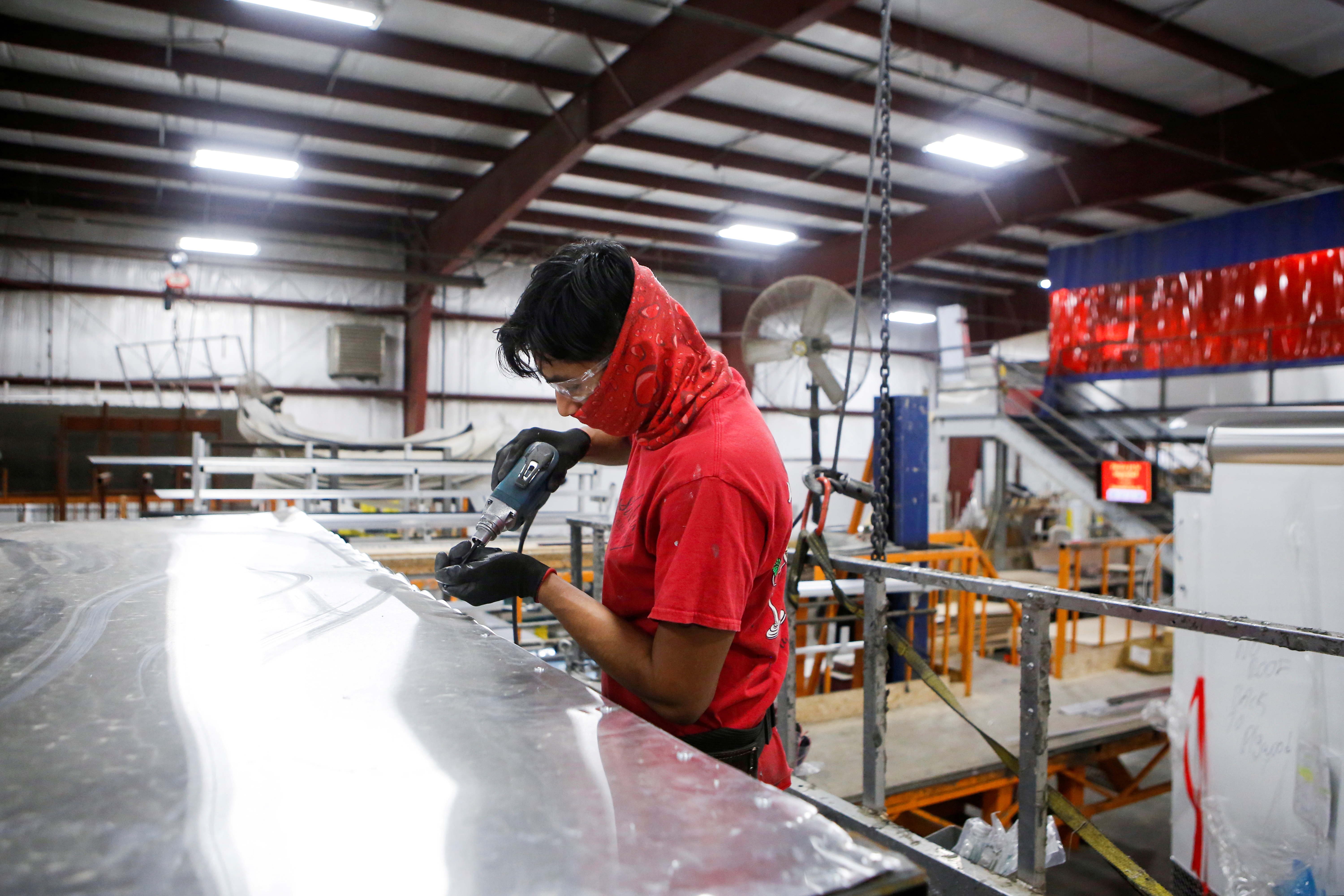Hector Torres installs an aluminium roof at Look Trailers cargo trailer manufacturing facility in Middlebury, Indiana, U.S., April 1, 2021. Picture taken April 1, 2021.  REUTERS/Eileen T. Meslar