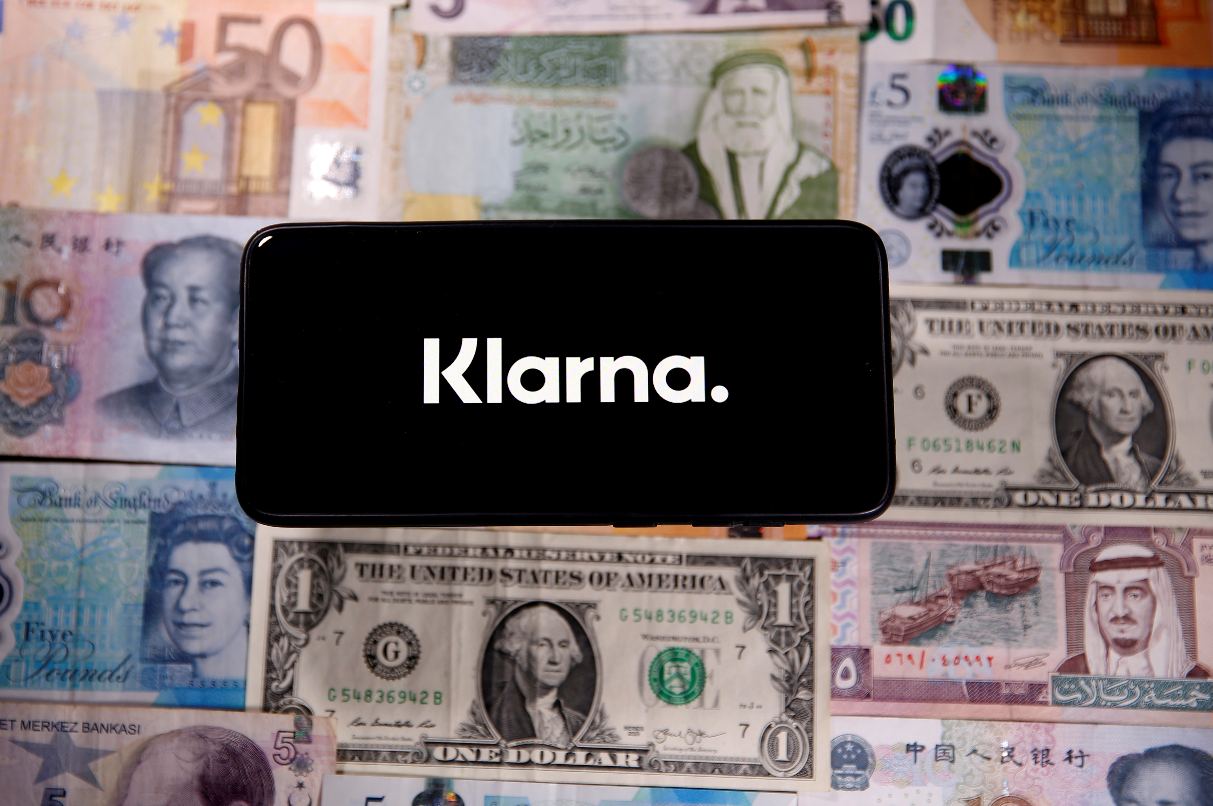 A smartphone displays a Klarna logo on top of banknotes is in this illustration taken January 6, 2020. REUTERS/Dado Ruvic/Illustration