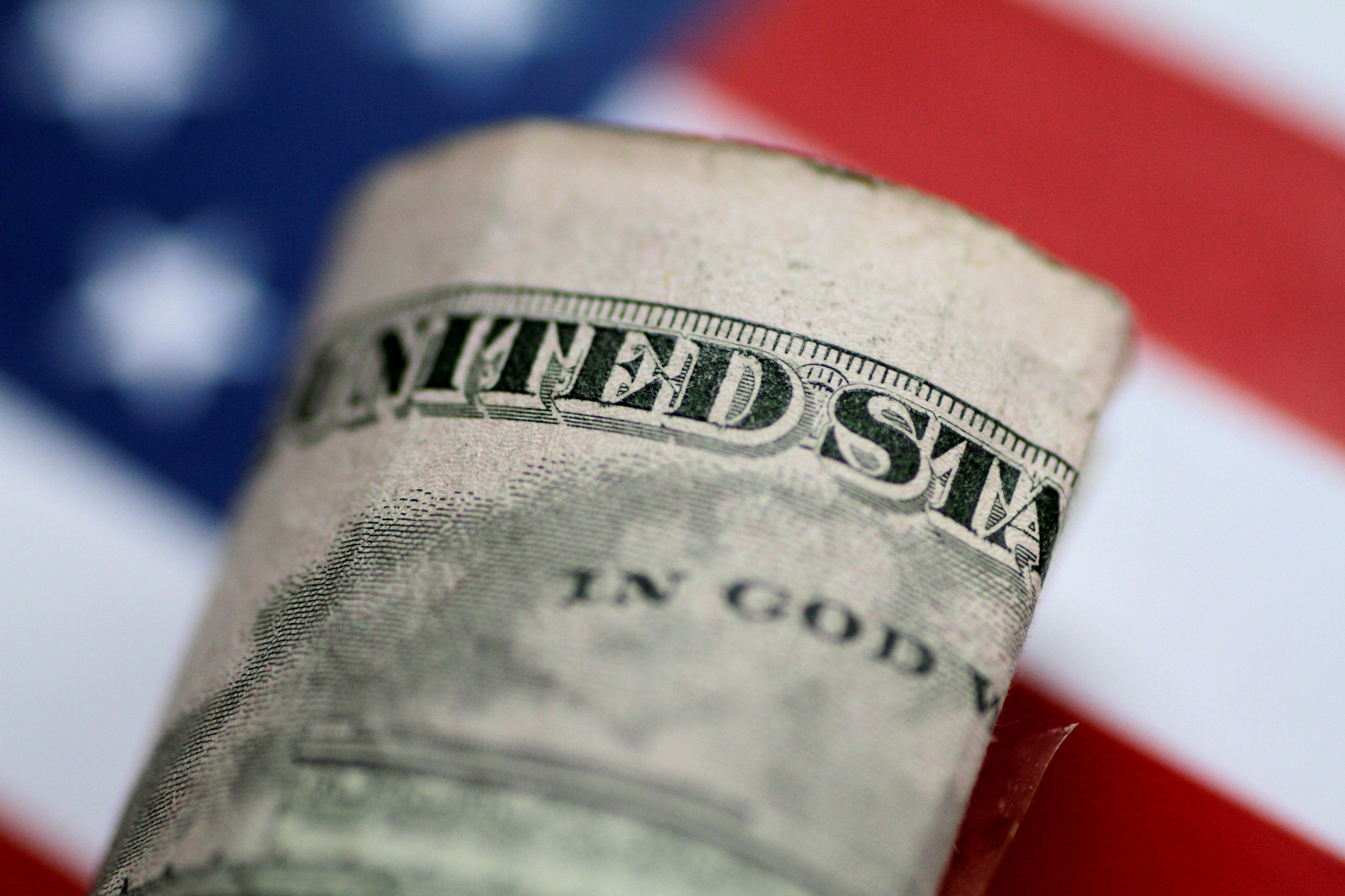 A U.S. five dollar note is seen in this illustration photo June 1, 2017.     REUTERS/Thomas White/Illustration/File Photo