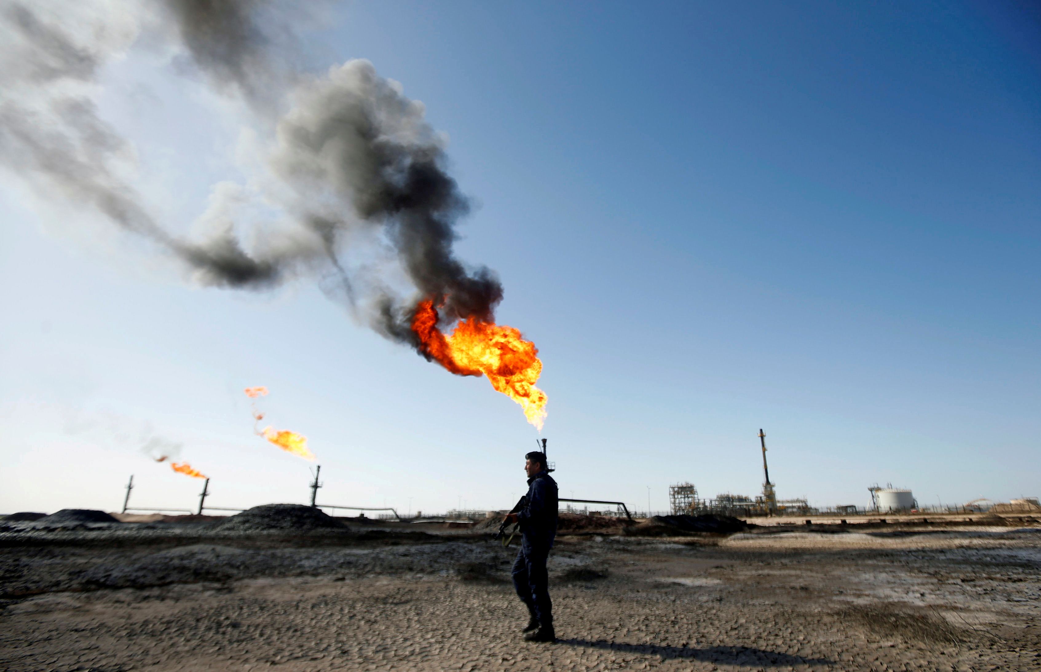 A policeman is seen at West Qurna-1 oil field, which is operated by ExxonMobil, in Basra, Iraq January 9, 2020. REUTERS/Essam al-Sudani/File Photo