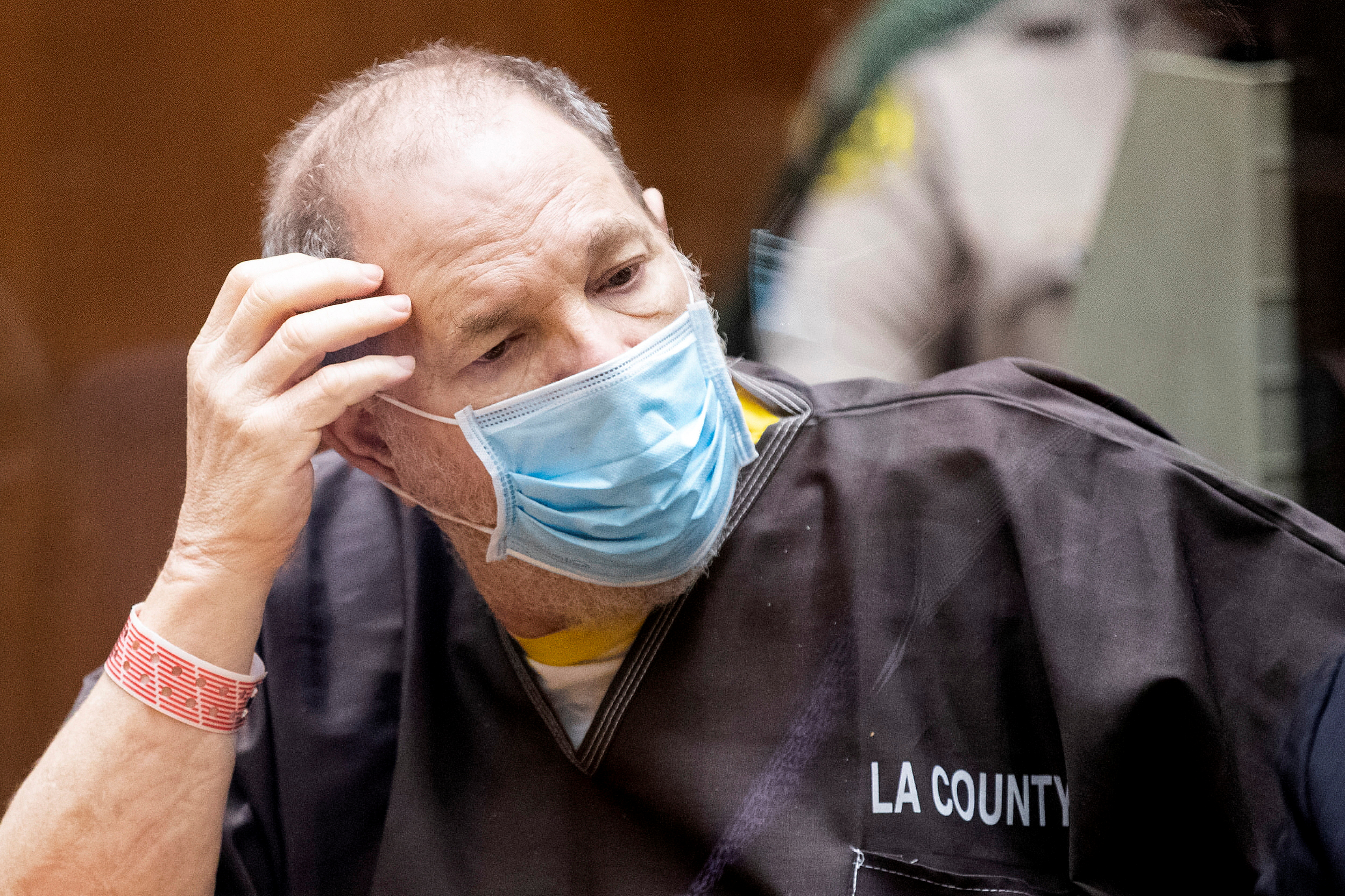 Harvey Weinstein, who was extradited from New York to Los Angeles to face sex-related charges, listens in court during a pre-trial hearing, in Los Angeles, California, U.S., July 29, 2021. Etienne Laurent/Pool via REUTERS