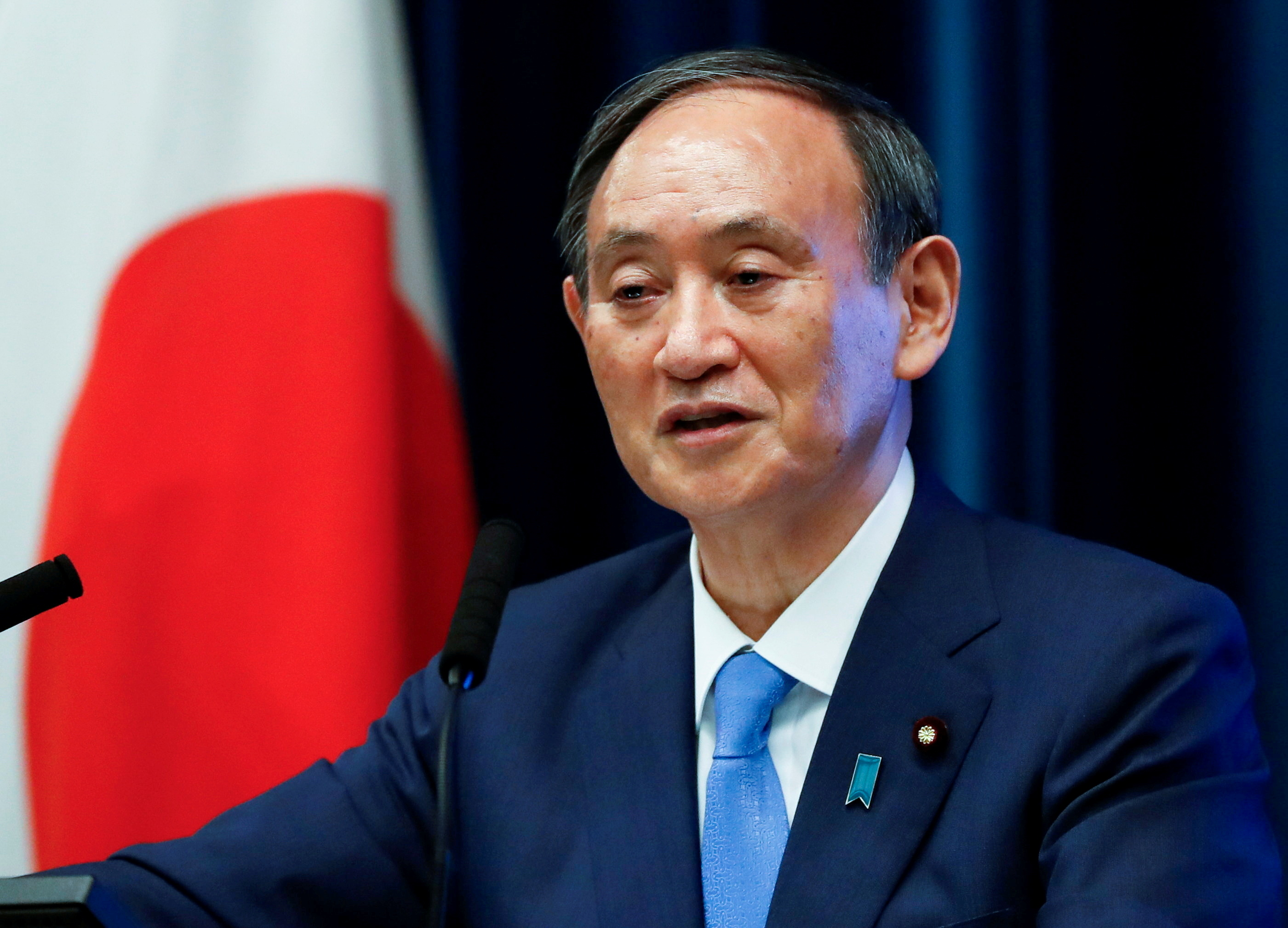 Japan's Prime Minister Yoshihide Suga attends a news conference on Japan's response to the coronavirus disease (COVID-19) outbreak, at his official residence in Tokyo, Japan, June 17, 2021. REUTERS/Issei Kato/Pool/File Photo