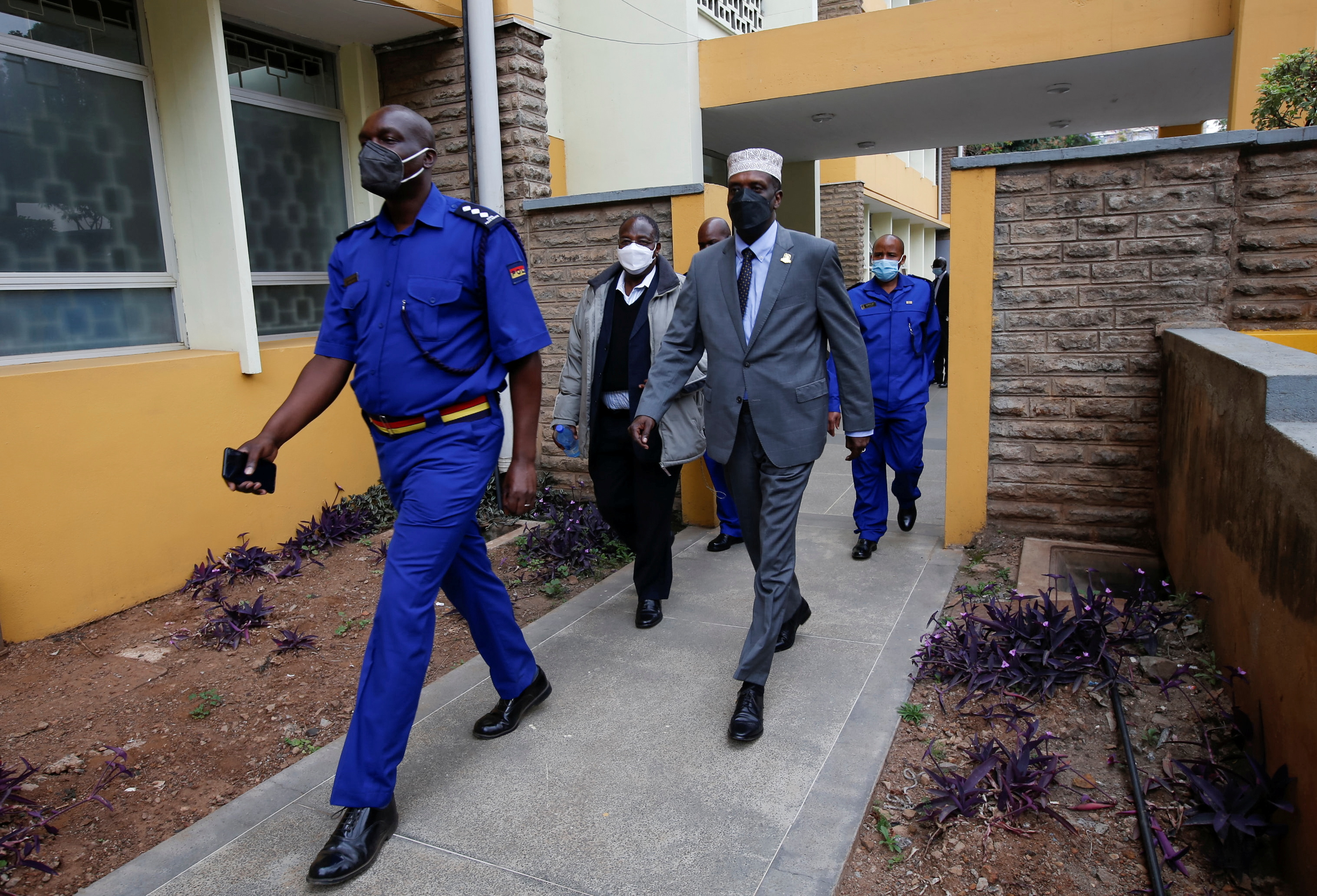 Former Kenyan sports minister Hassan Wario is escorted by security officers after he was found guilty of corruption charges in connection with the 2016 Rio Olympics funds, at the Milimani Law Courts in Nairobi, Kenya September 16, 2021. REUTERS/Monicah Mwangi
