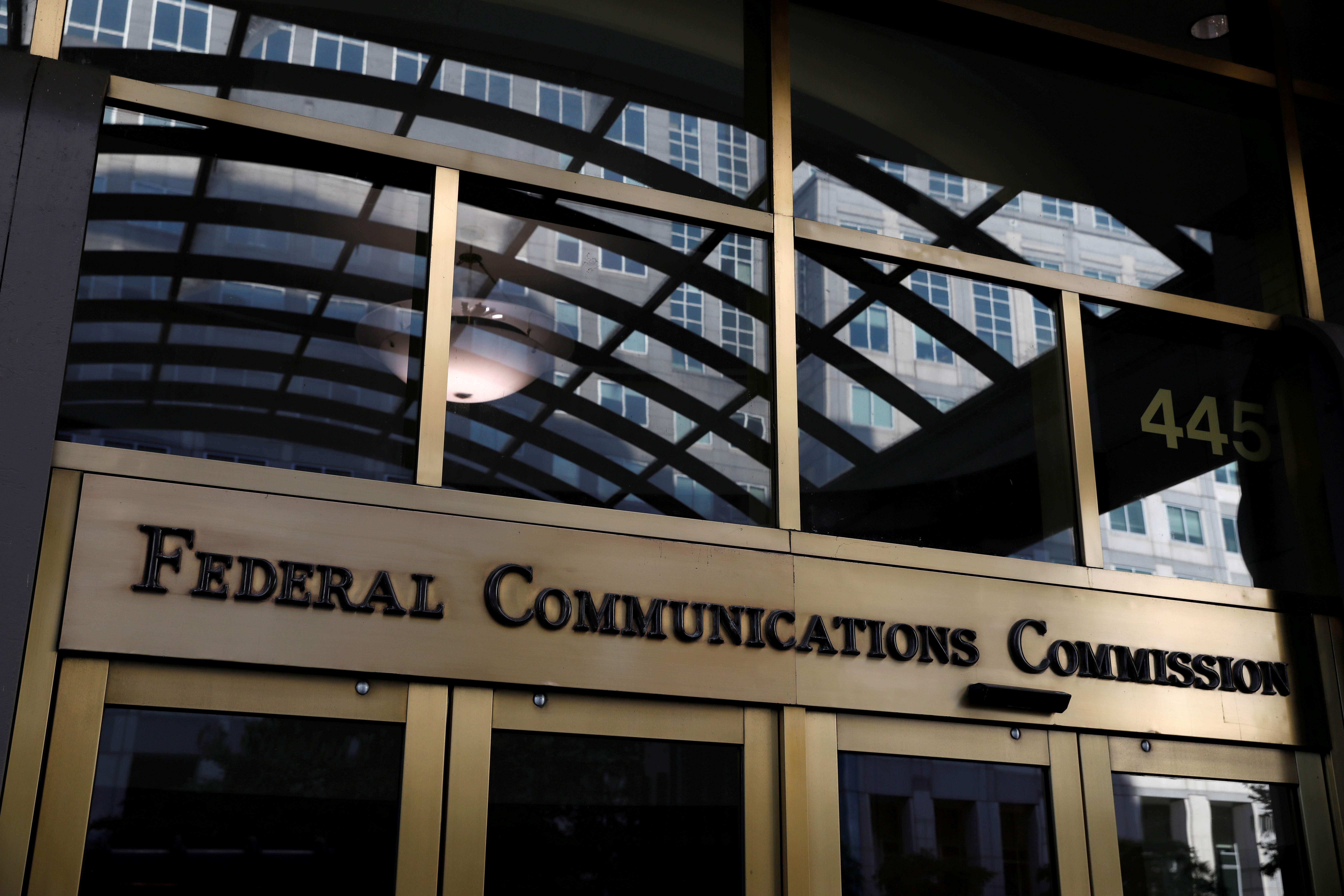 Signage is seen at the headquarters of the Federal Communications Commission in Washington, D.C., U.S., August 29, 2020. REUTERS/Andrew Kelly/File Photo