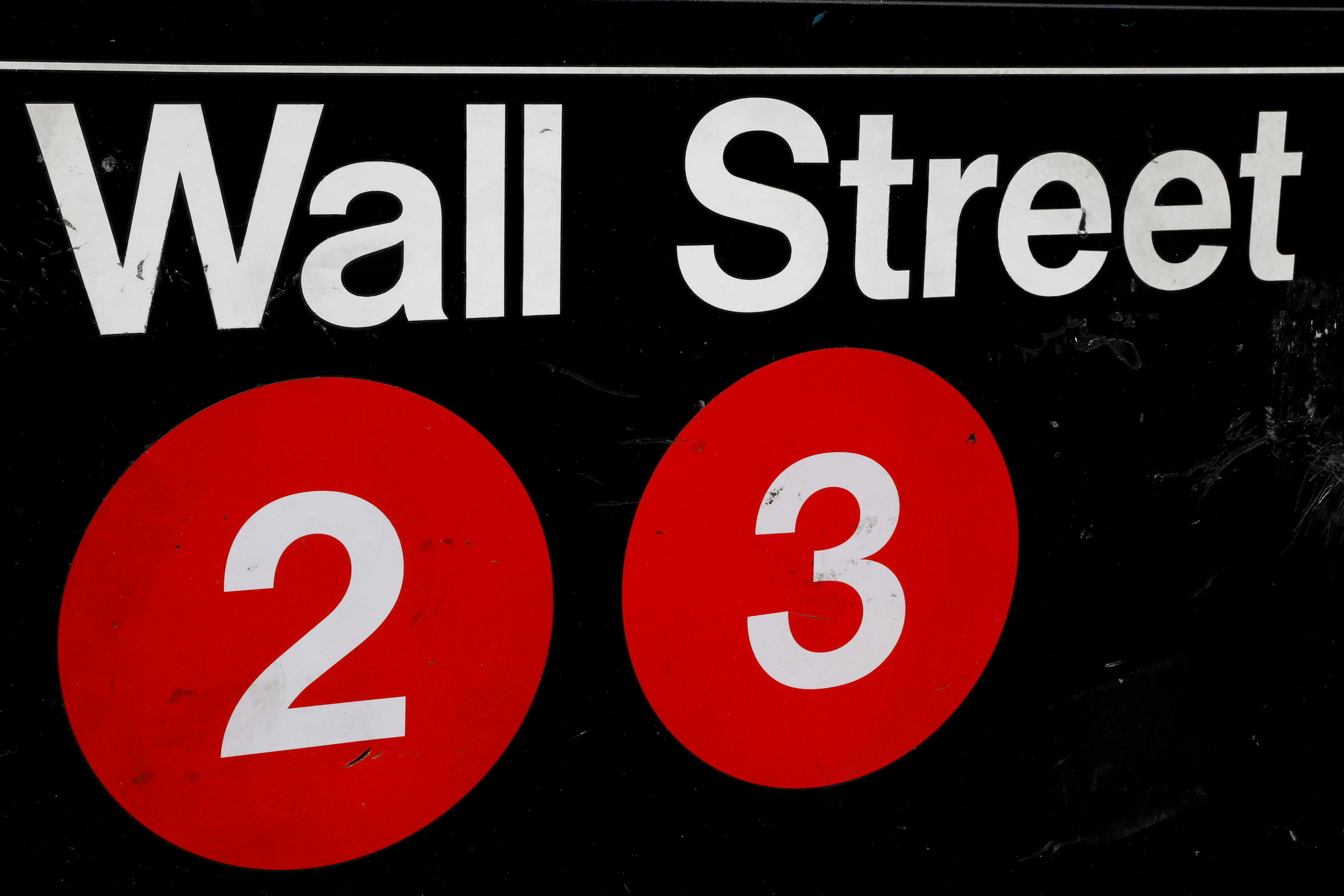 A sign for the Wall Street subway station is seen in the financial district in New York City, U.S., August 23, 2018. REUTERS/Brendan McDermid