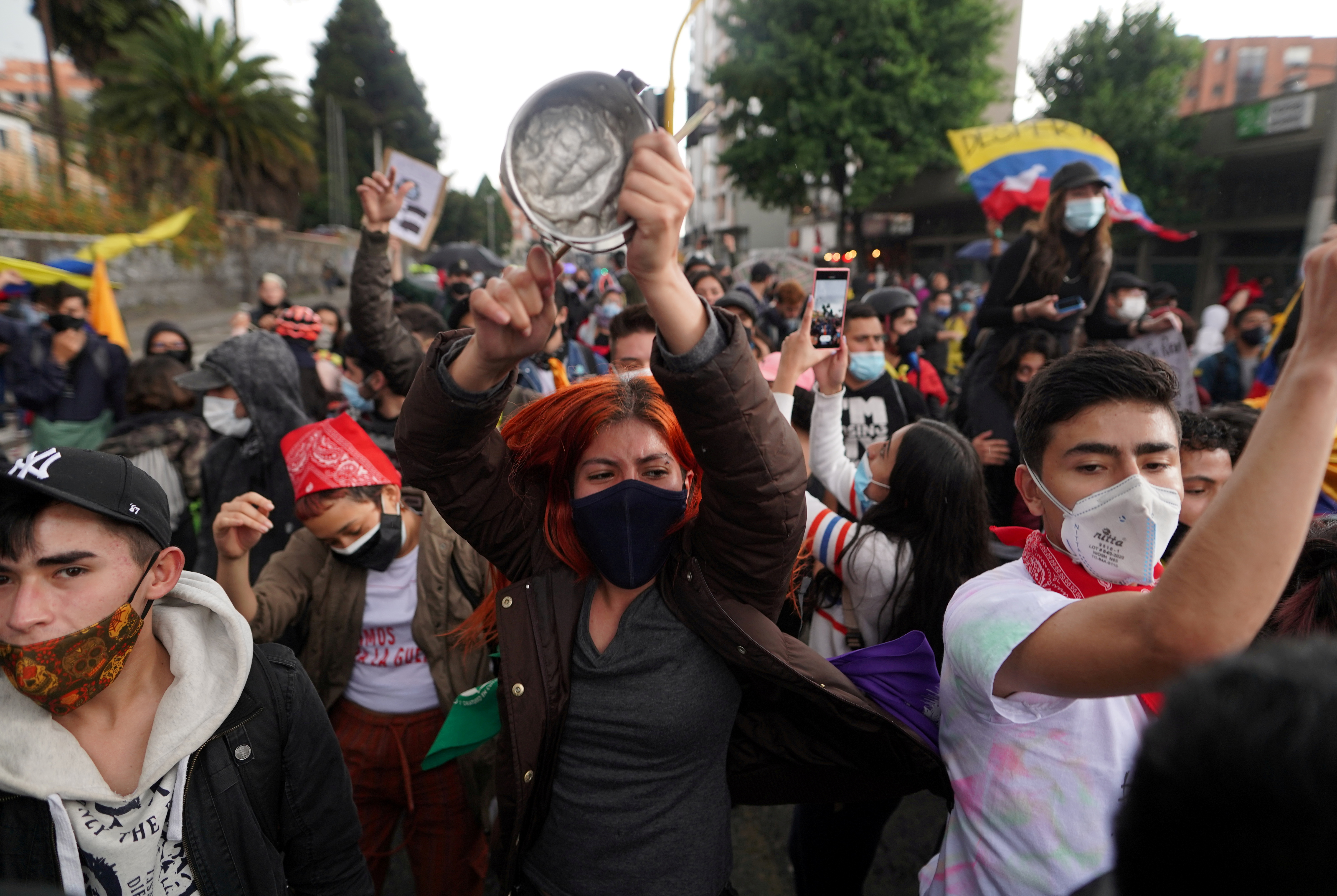 Demonstrators participate in a protest against poverty and police violence, in Bogota, Colombia May 4, 2021. REUTERS/Nathalia Angarita