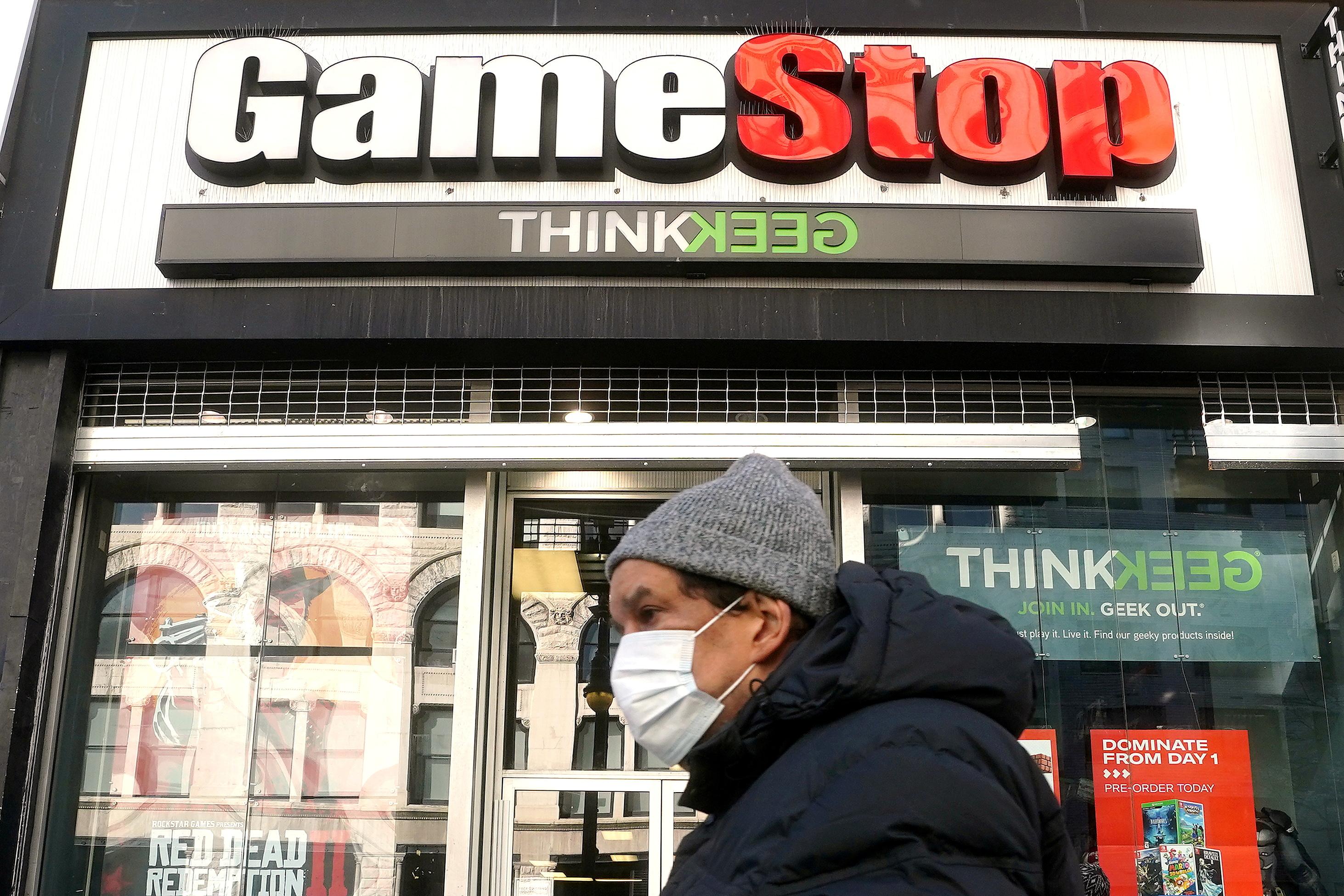 A person walks past a GameStop in the Manhattan borough of New York City, New York, U.S., January 29, 2021. REUTERS/Carlo Allegri/File Photo