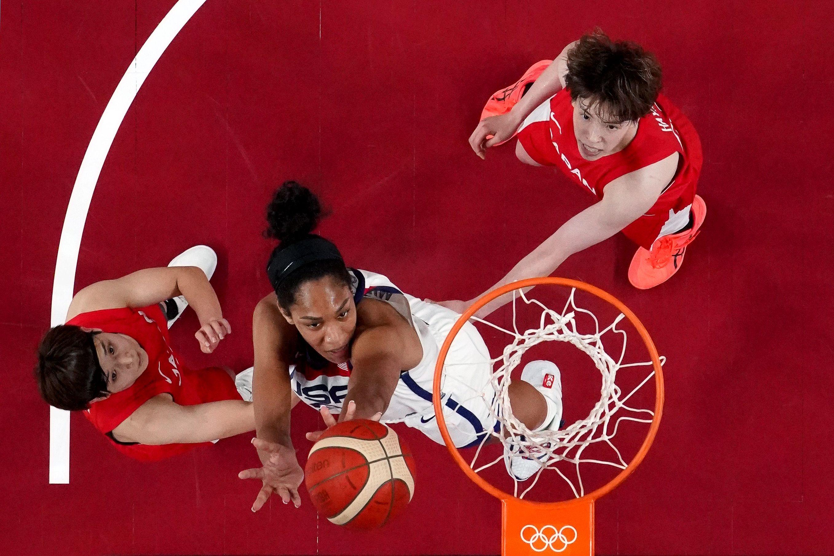 Tokyo 2020 Olympics - Basketball - Women - Group B - United States v Japan - Saitama Super Arena, Saitama, Japan - July 30, 2021. Saki Hayashi of Japan ans Rui Machida of Japan in action with A'Ja Wilson of the United States REUTERS/Brian Snyder