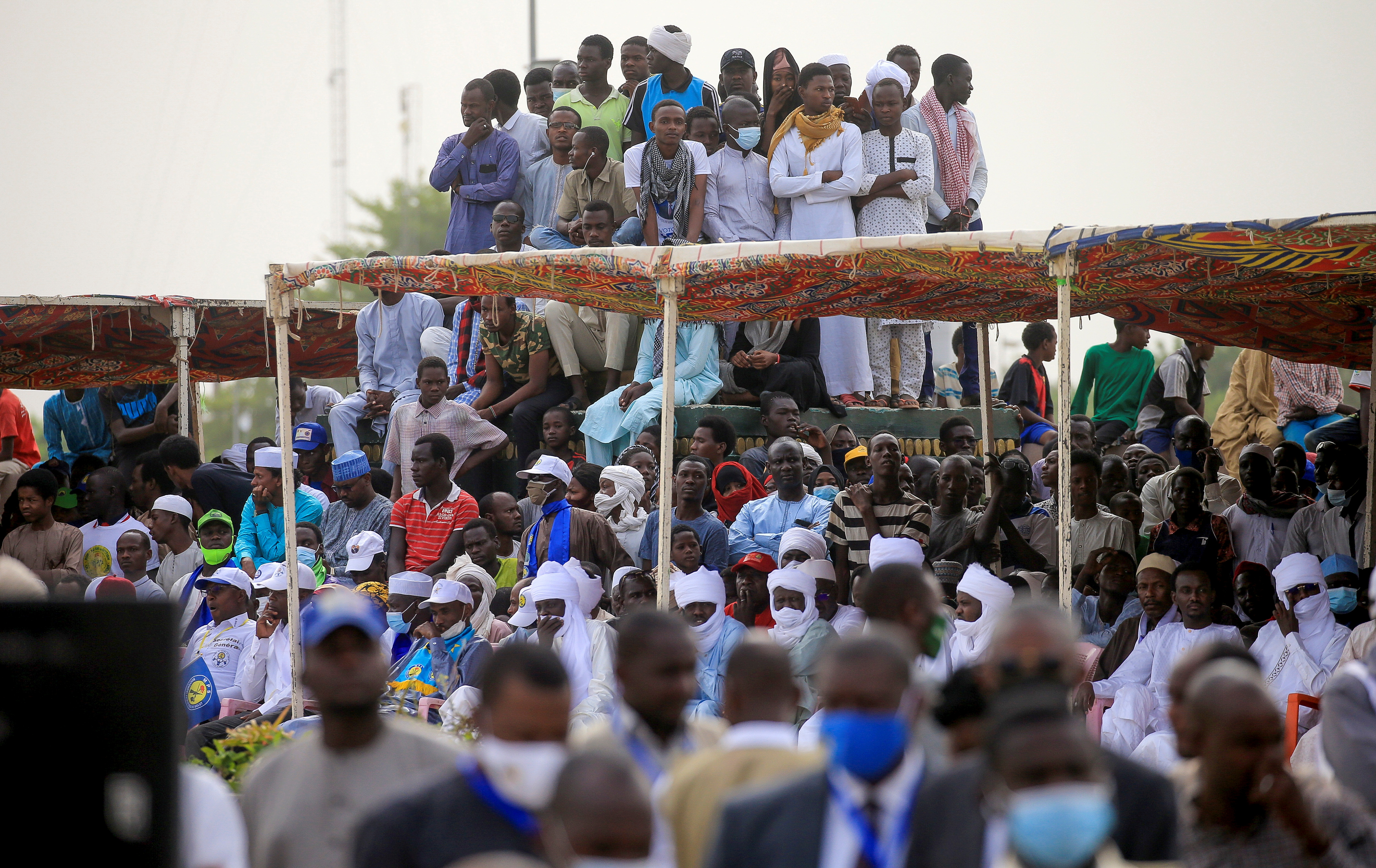 A crowd gathers to witness the state funeral for the late Chadian President Idriss Deby in N'Djamena, Chad April 23, 2021. Christophe Petit Tesson/Pool via REUTERS