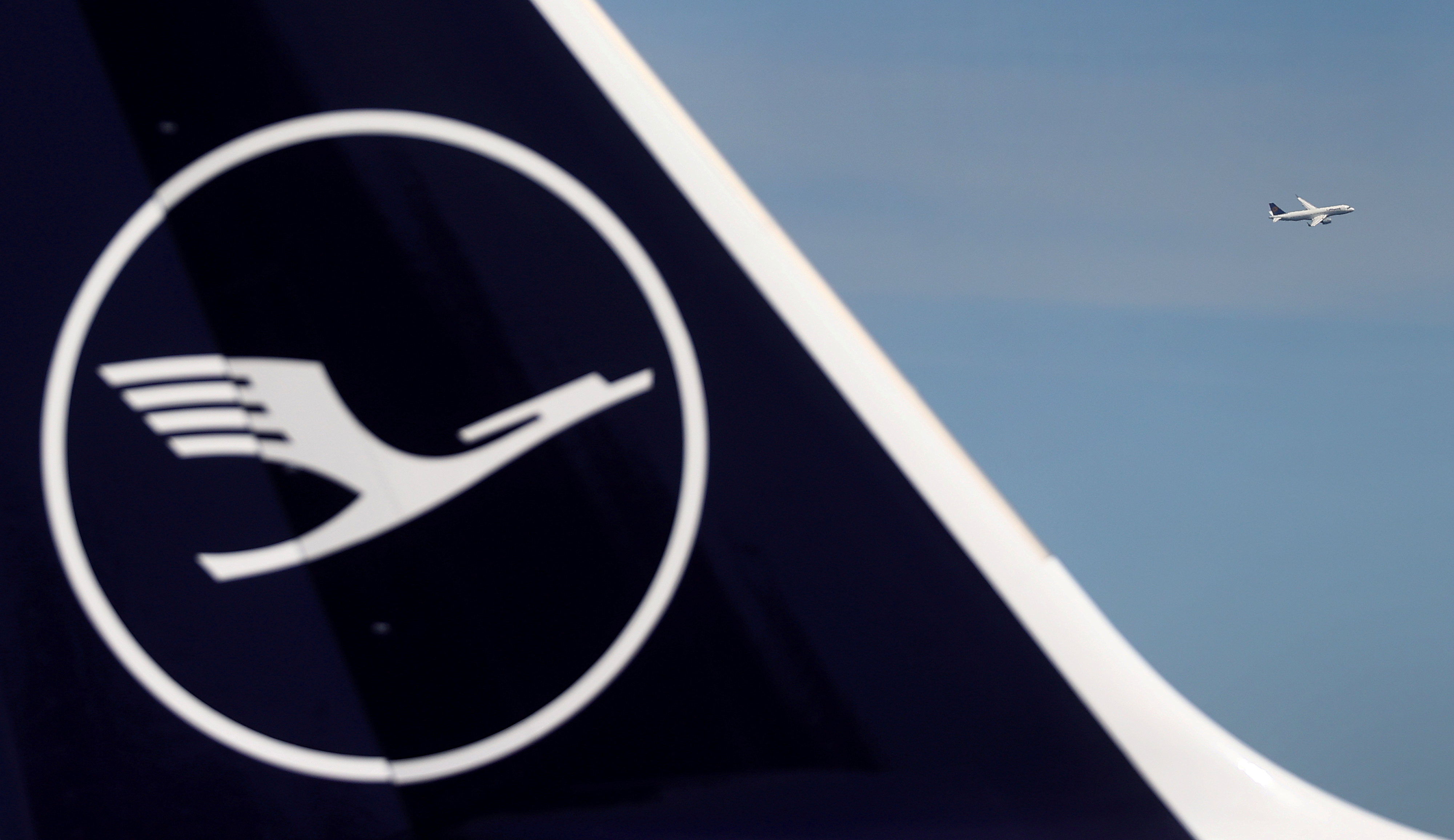 A Lufthansa plane takes off behind a grounded jet at the airport as the spread of coronavirus disease (COVID-19) continues in Frankfurt, Germany, June 2, 2020. REUTERS/Kai Pfaffenbach
