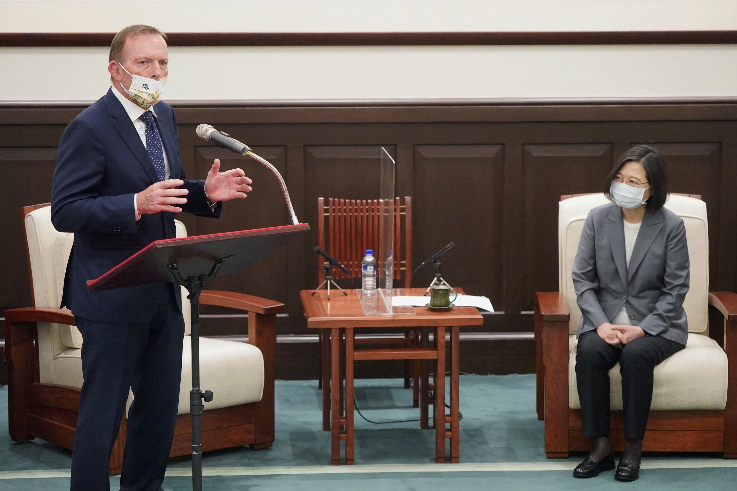 Former Australian Prime Minister Tony Abbott speaks next to Taiwan's President Tsai Ing-wen during their meeting in Taipei, Taiwan October 7, 2021. Central News Agency/Pool via REUTERS