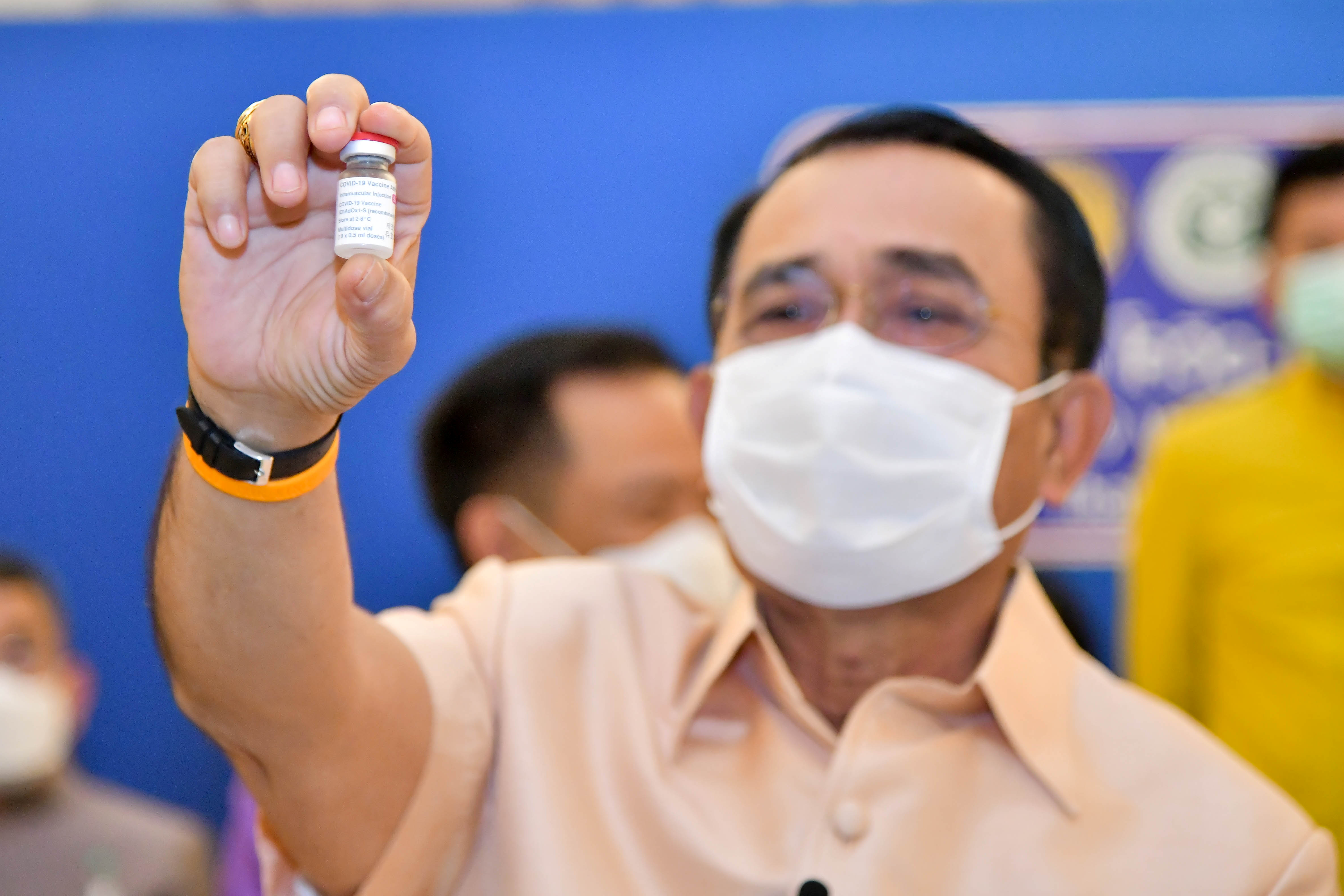 Thailand's Prime Minister Prayuth Chan-ocha holds up a vial of the AstraZeneca coronavirus disease (COVID-19) vaccine before receiving an injection at the Government House in Bangkok, Thailand, March 16, 2021. Thailand Government House/Handout via REUTERS