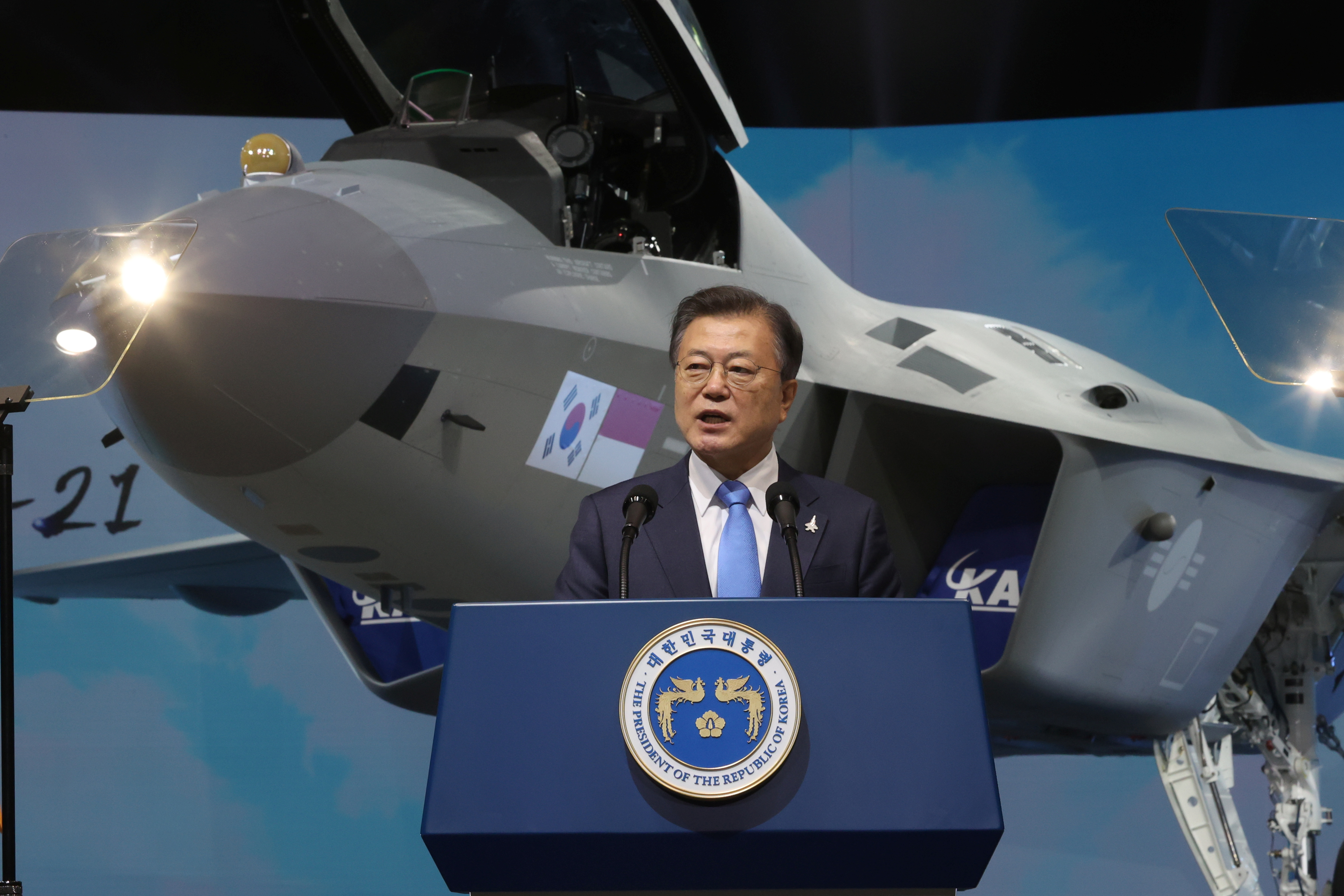 South Korean President Moon Jae-in delivers his speech in front of a prototype of the country's first homegrown fighter jet called KF-21 during its rollout ceremony in Sacheon, South Korea, April 9, 2021.   Yonhap via REUTERS