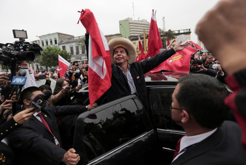 Peru's presidential candidate Pedro Castillo gestures to supporters the day after a run-off election, in Lima, Peru June 7, 2021. REUTERS/Gerardo Marin