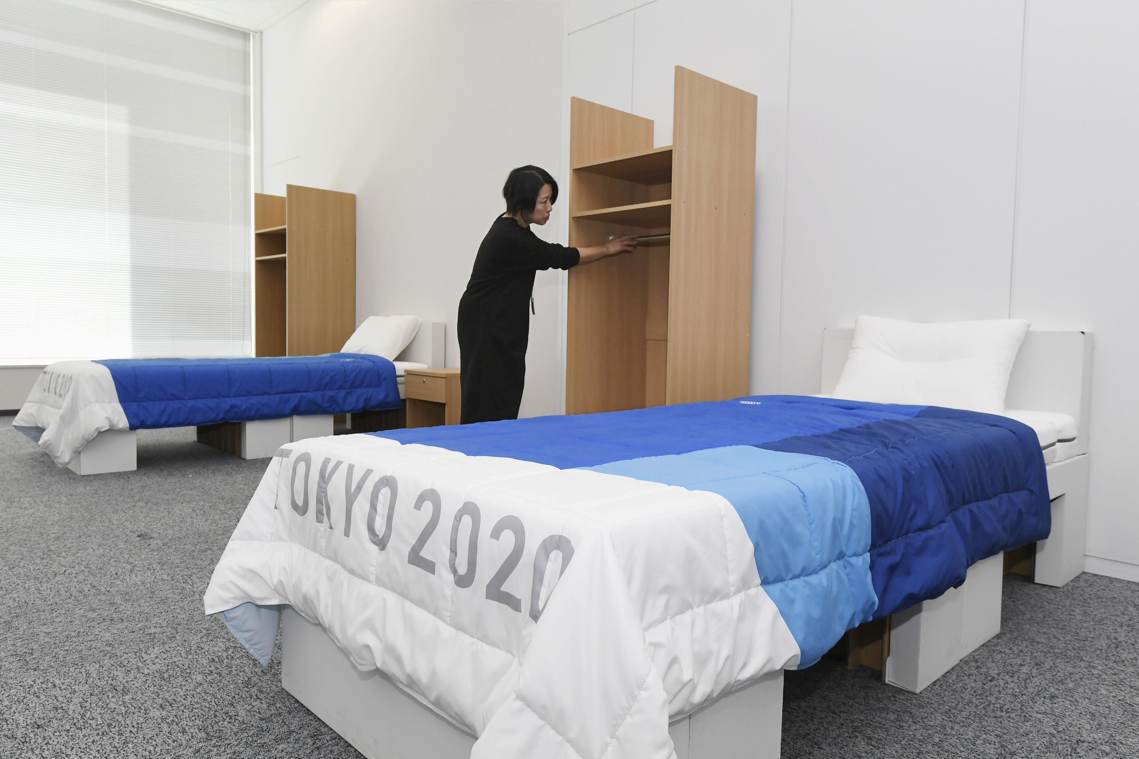 Irish gymnast leaps on cardboard beds at Athletes Village to bust  'anti-sex' myth | Reuters