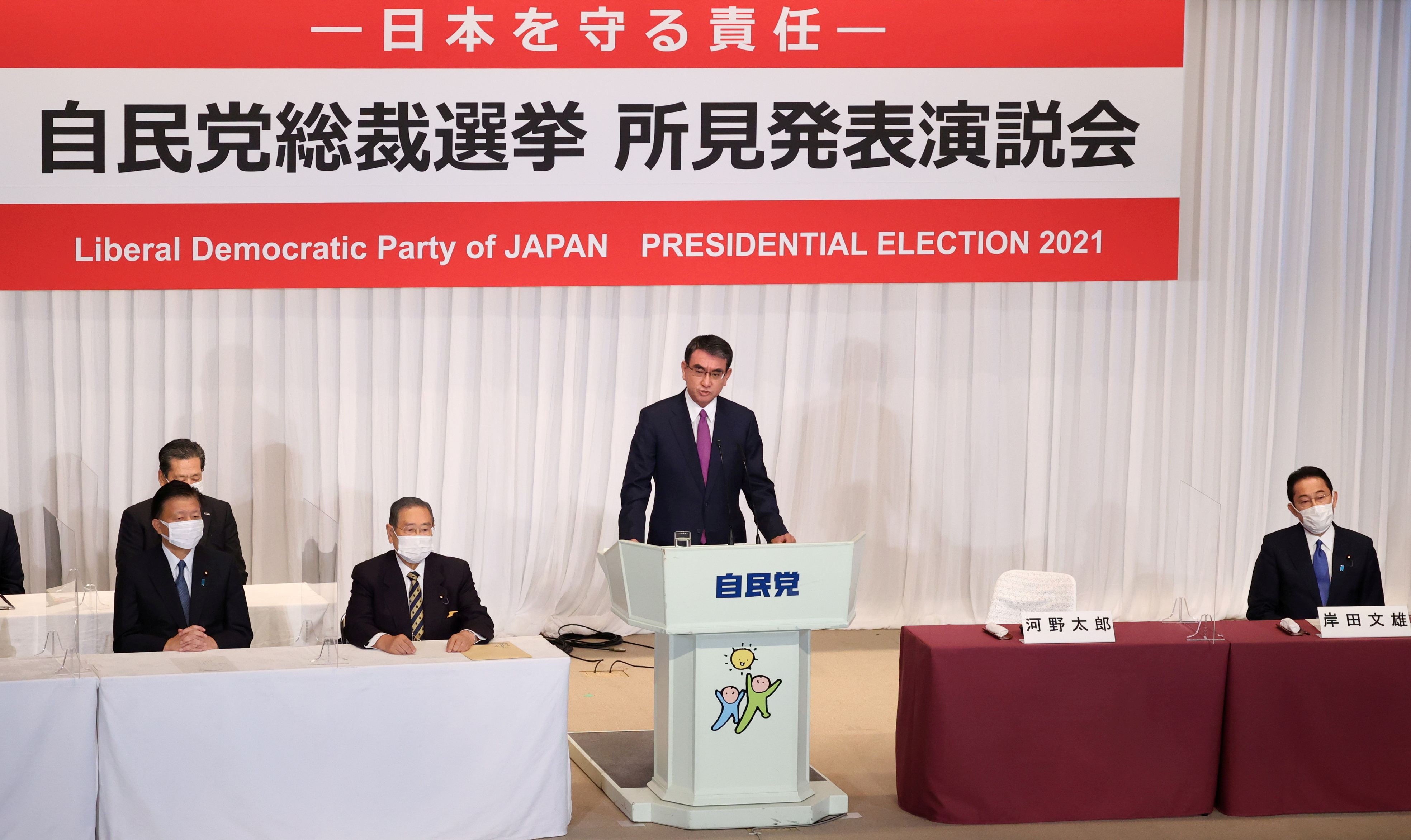 Japan's Administrative Reform Minister Taro Kono, candidate of the ruling Liberal Democratic Party (LDP) presidential election, delivers a campaign speech, while another candidate former Japanese Foreign Minister Fumio Kishida listens, during a joint news conference in Tokyo, Japan September 17, 2021.  Yoshikazu Tsuno/Pool via REUTERS