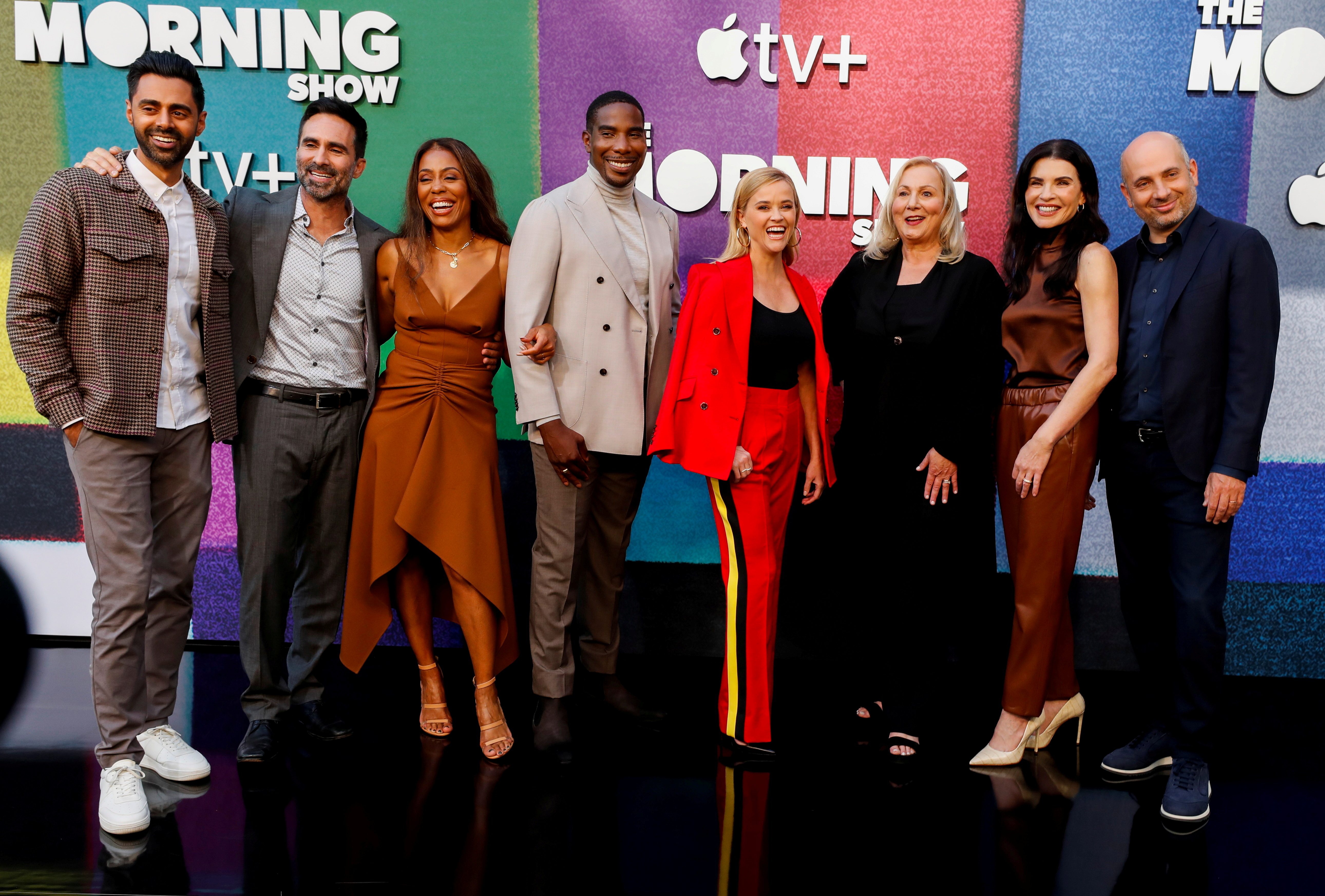 Cast member and executive producer Reese Witherspoon (in red) poses with co-stars Hasan Minhaj, Nestor Carbonell, Karen Pittman, Desean K. Terry, Julianna Margulies and director Mimi Leder and executive producer Michael Ellenberg at a photo call for season two of the television series