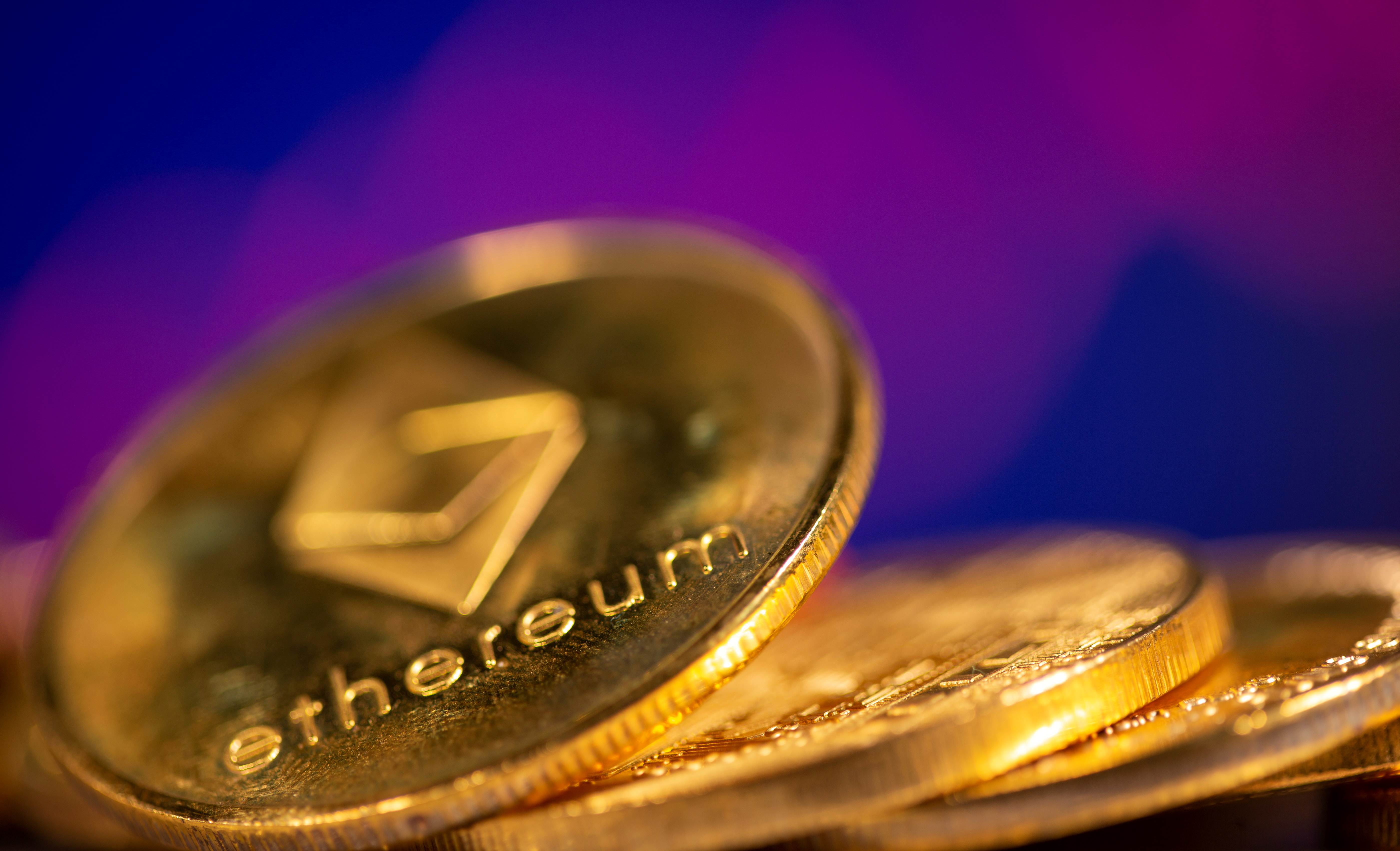 A representation of virtual currency Ethereum are seen in front of a stock graph in this illustration taken February 19, 2021. REUTERS/Dado Ruvic/Illustration
