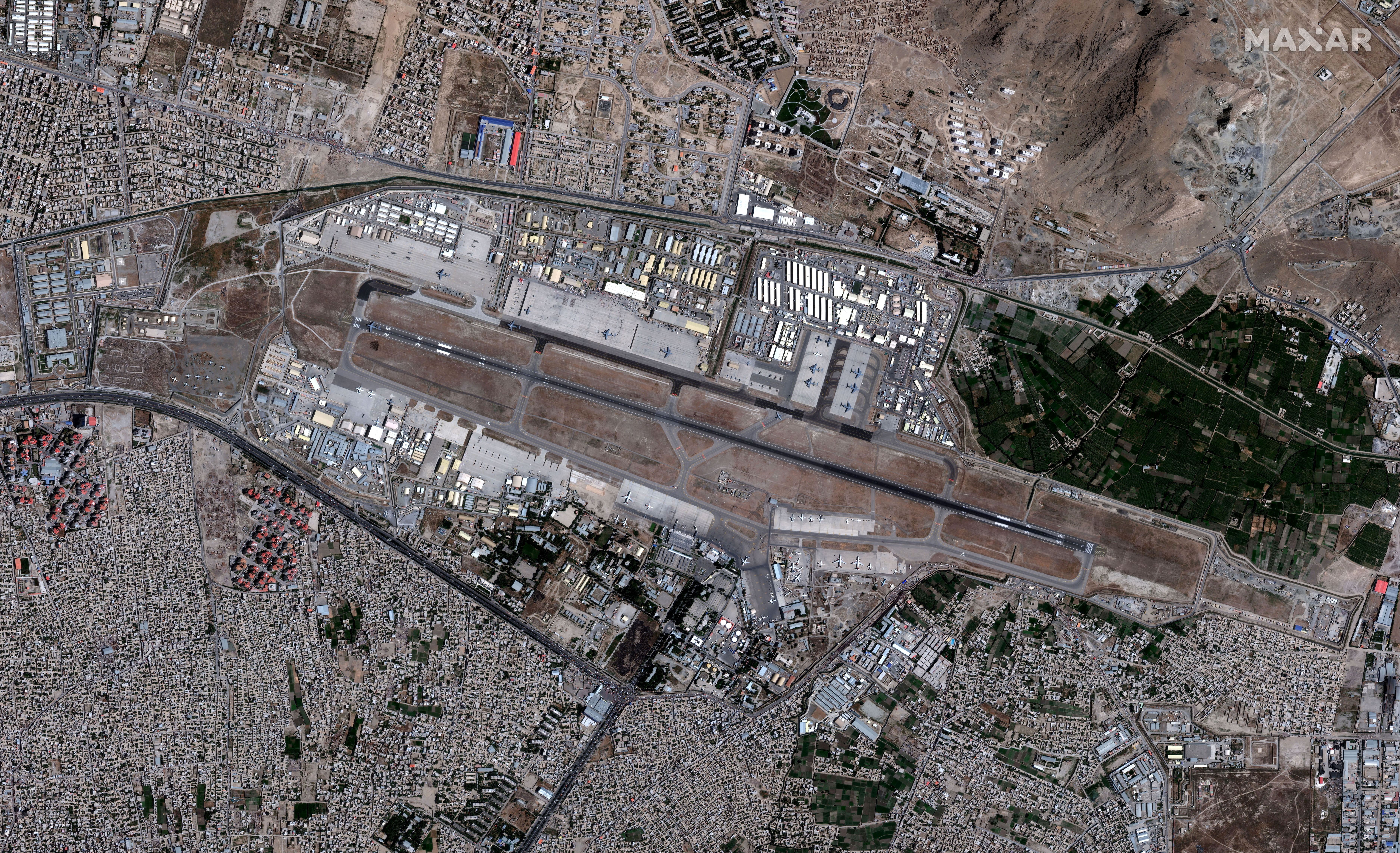 An overview of the Hamid Karzai International Airport, in Kabul, Afghanistan August 24, 2021, in this satellite image obtained by Reuters on August 26, 2021.  Satellite image 2021 Maxar Technologies/Handout via REUTERS.