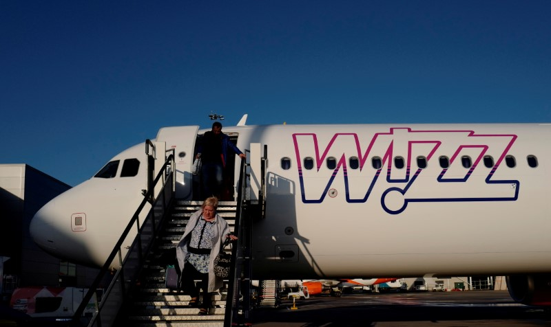 A Wizz Air Airbus 321-231 aircraft, registration number HA-LXT, is pictured at the London Luton Airport, Luton, Britain, April 11, 2019. Picture taken on April 11, 2019. REUTERS/Kacper Pempel/File Photo