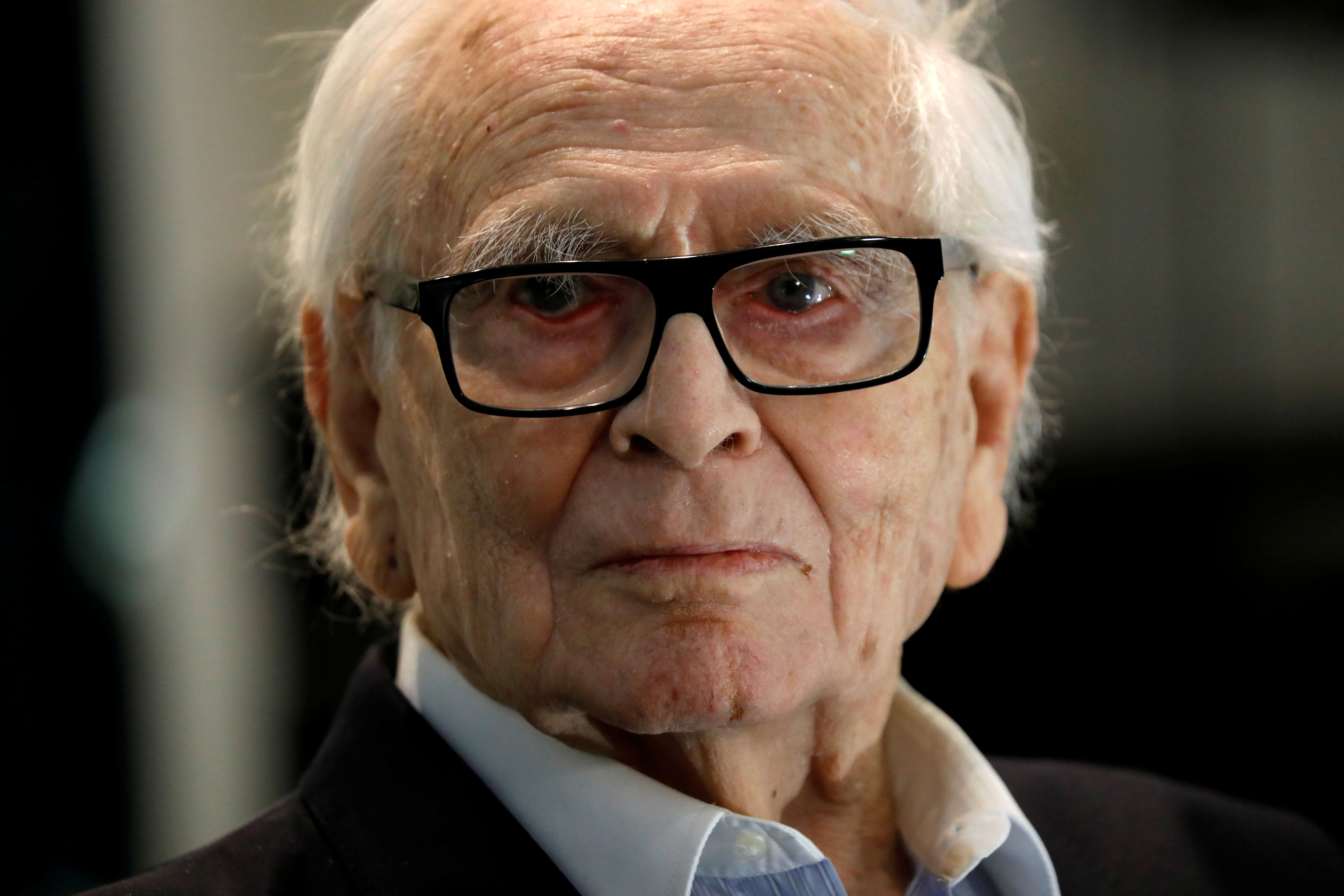 French fashion designer Pierre Cardin, 97, poses during a presentation of a collection made in partnership with Pierre Courtial, a young designer he trained himself at his Studio Pierre Cardin in Paris, France, February 27, 2020. REUTERS/Charles Platiau/File Photo