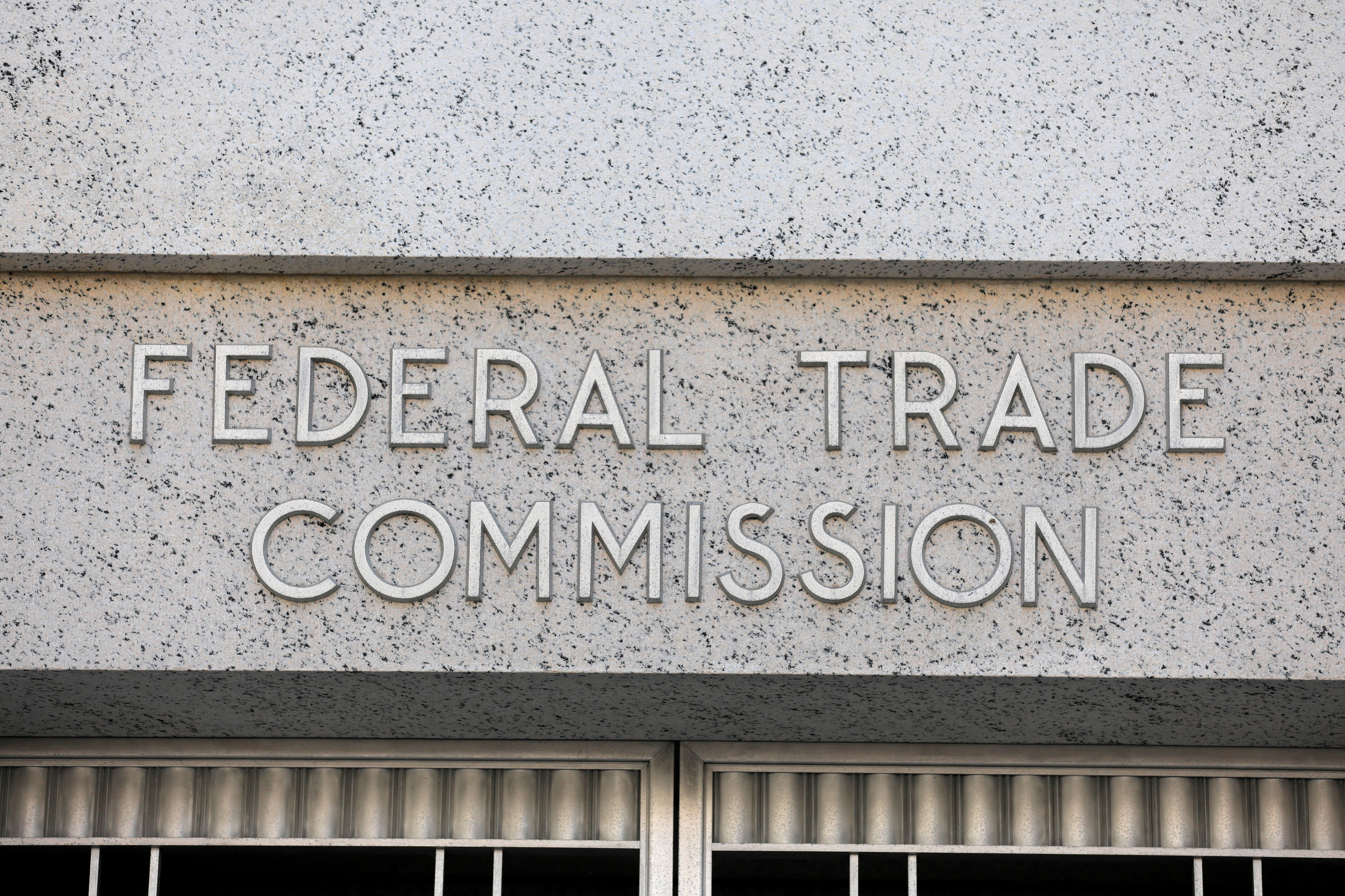 FILE PHOTO: Signage is seen at the Federal Trade Commission headquarters in Washington, D.C., U.S., August 29, 2020. REUTERS/Andrew Kelly