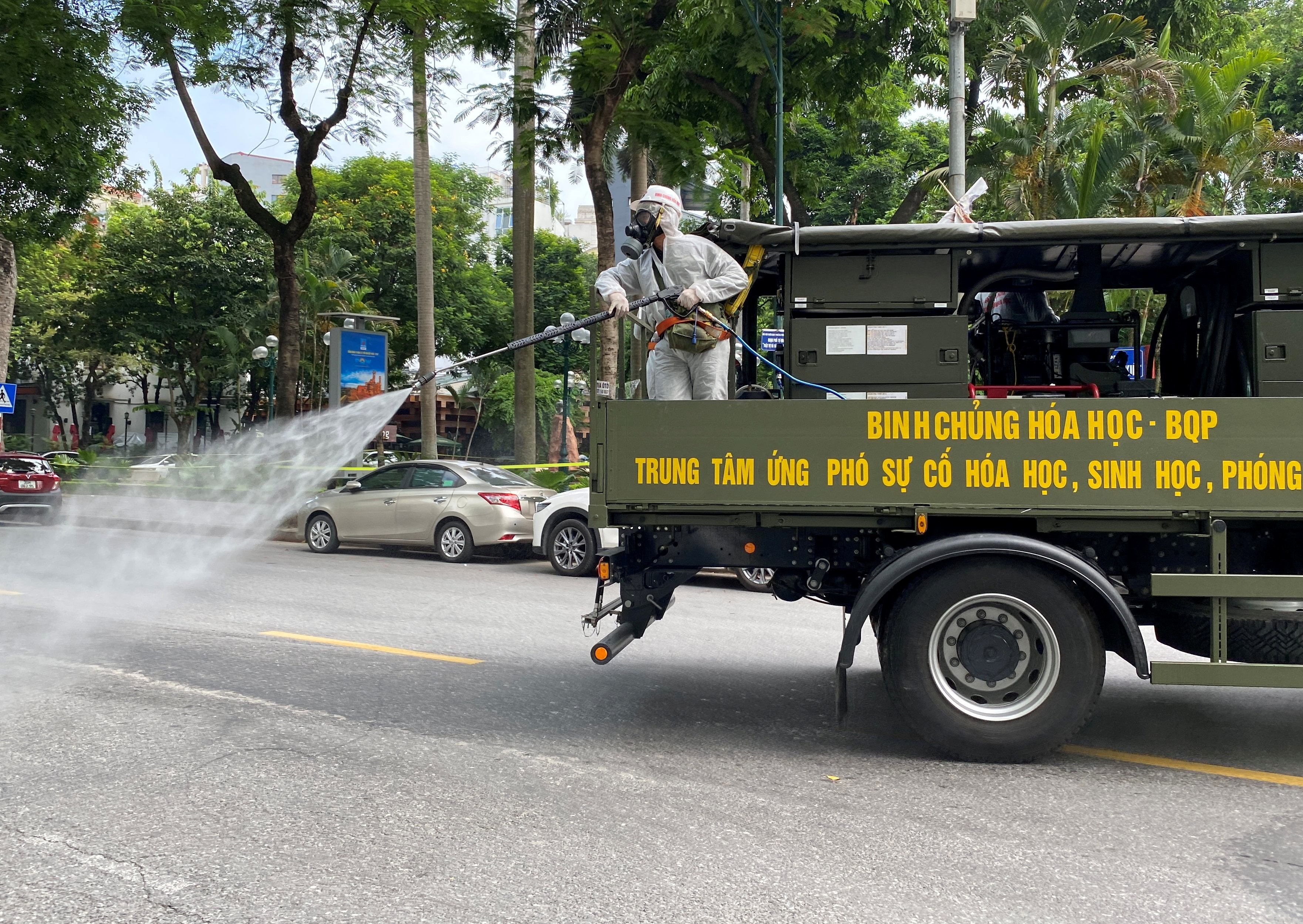 Military personnel spray disinfectant on the streets during a lockdown designed to curb the spread of COVID-19 in Hanoi, Vietnam, on July 26, 2021. REUTERS/Stringer/File Photo