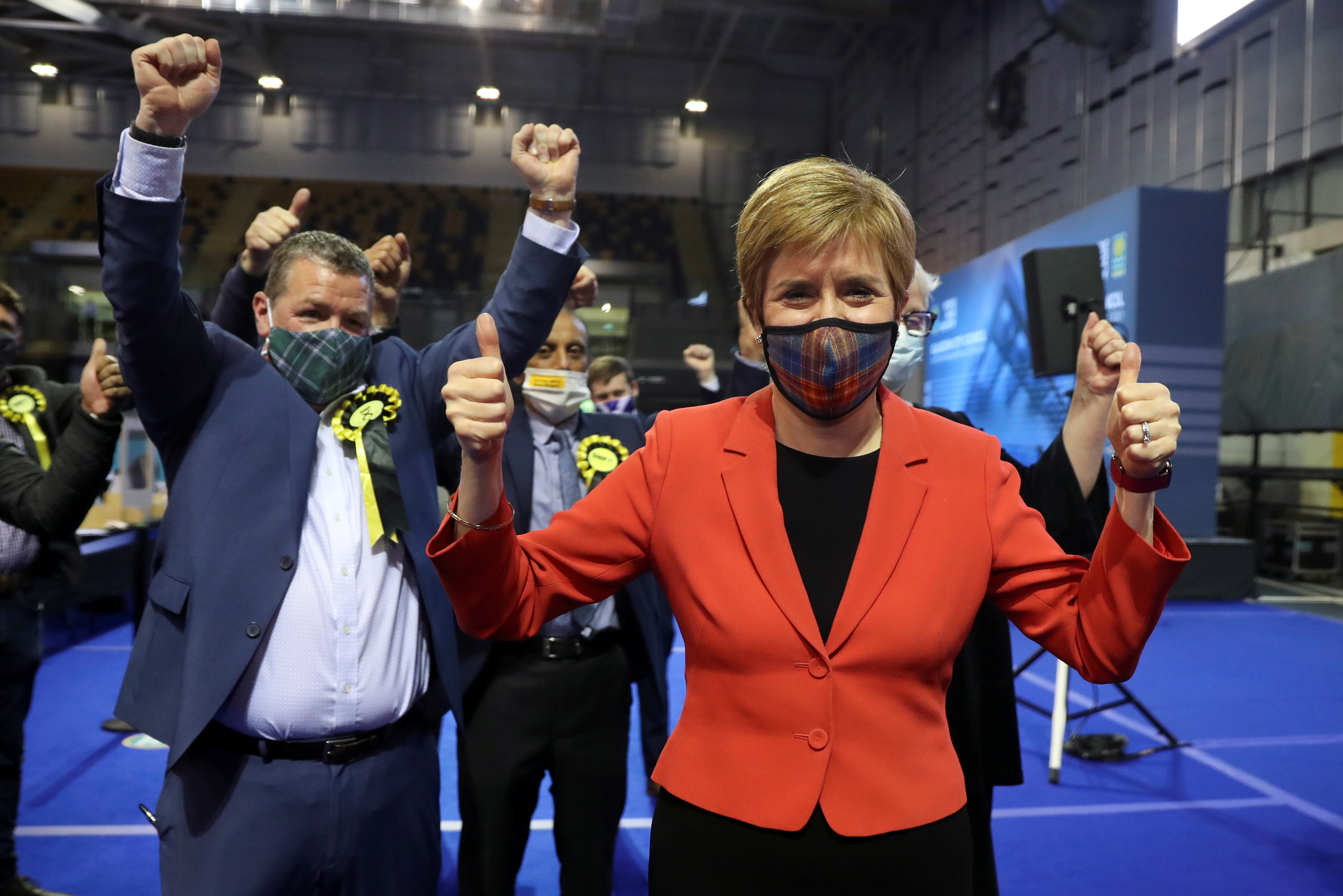 Scottish First Minister Nicola Sturgeon gestures as she visits a counting centre as votes are counted for the Scottish Parliamentary election, in Glasgow, Scotland, Britain, May 7, 2021. REUTERS/Russell Cheyne
