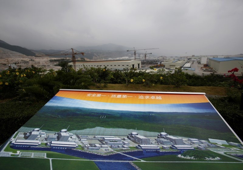 An artist impression of Taishan Nuclear Power Plant, to be operated by China Guangdong Nuclear Power (CGN), is displayed on a viewing platform overlooking the construction site in Taishan, Guangdong province, October 17, 2013.  REUTERS/Bobby Yip/File Photo