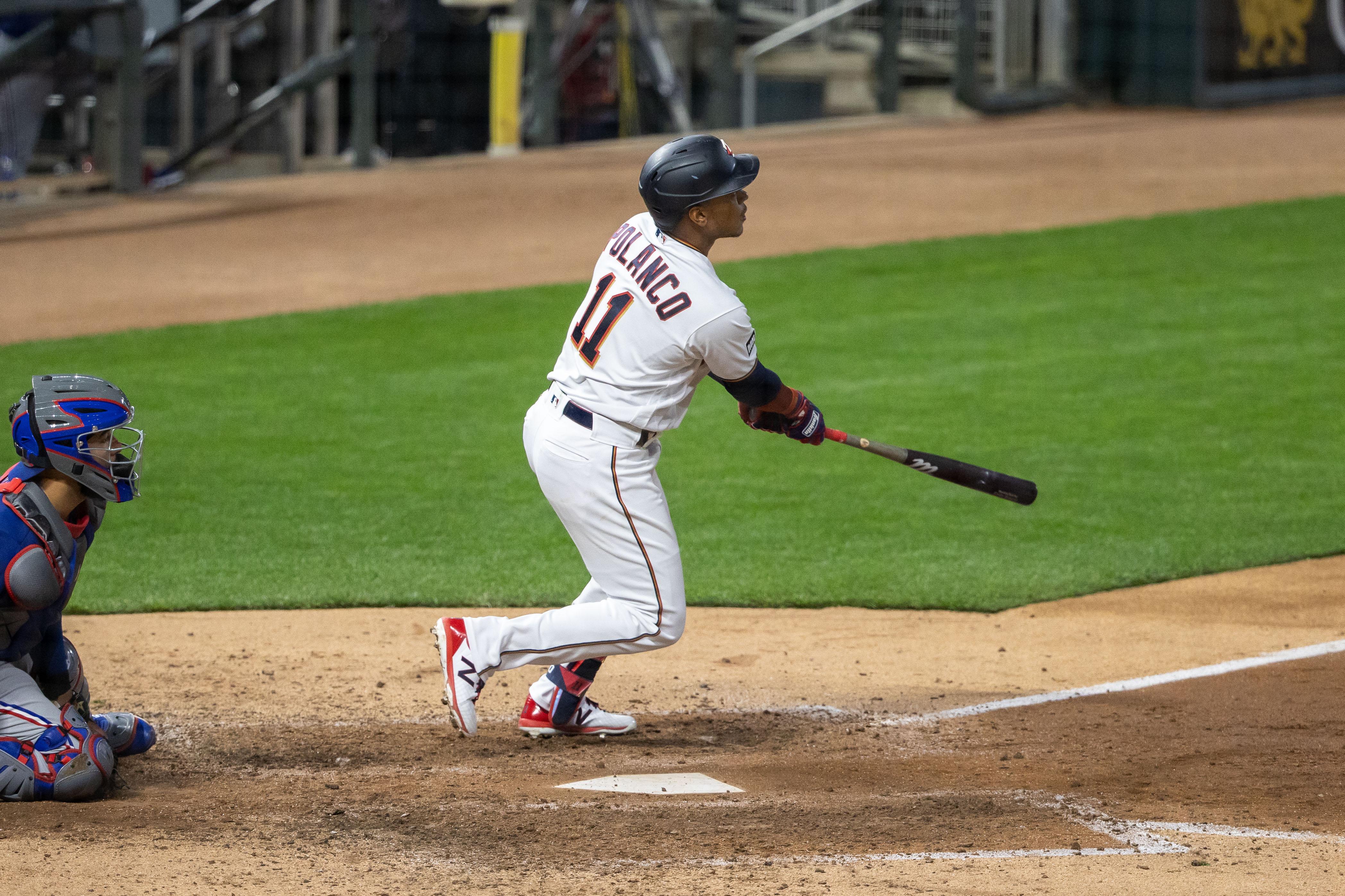May 3, 2021; Minneapolis, Minnesota, USA; Minnesota Twins second baseman Jorge Polanco (11) hits a RBI triple during the sixth inning against the Texas Rangers at Target Field. Mandatory Credit: Jordan Johnson-USA TODAY Sports