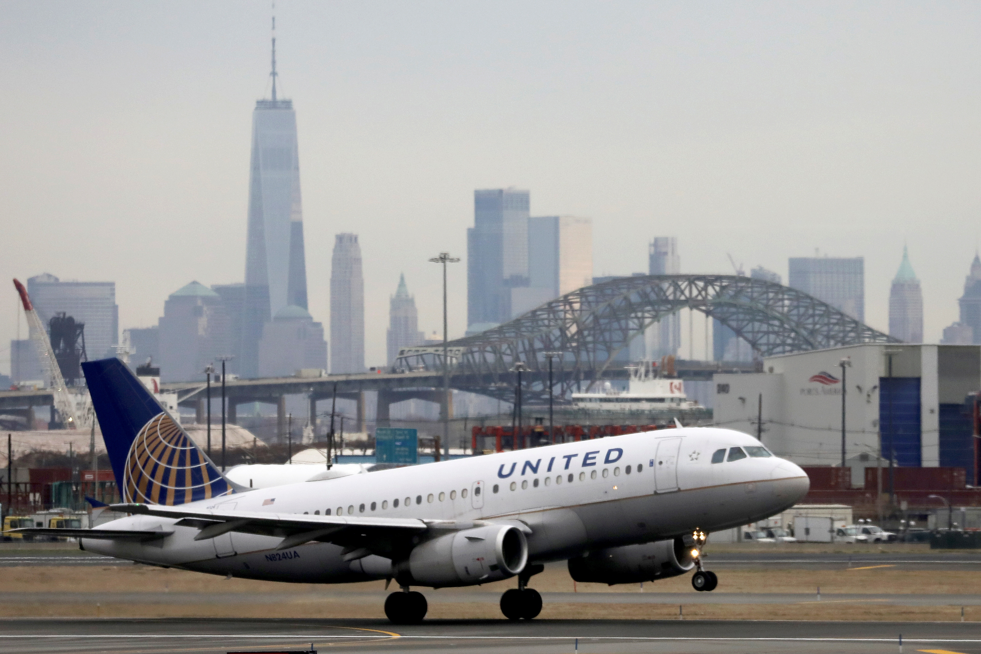 A United Airlines passenger jet takes off with New York City as a backdrop, at Newark Liberty International Airport, New Jersey, U.S. December 6, 2019. REUTERS/Chris Helgren/File Photo