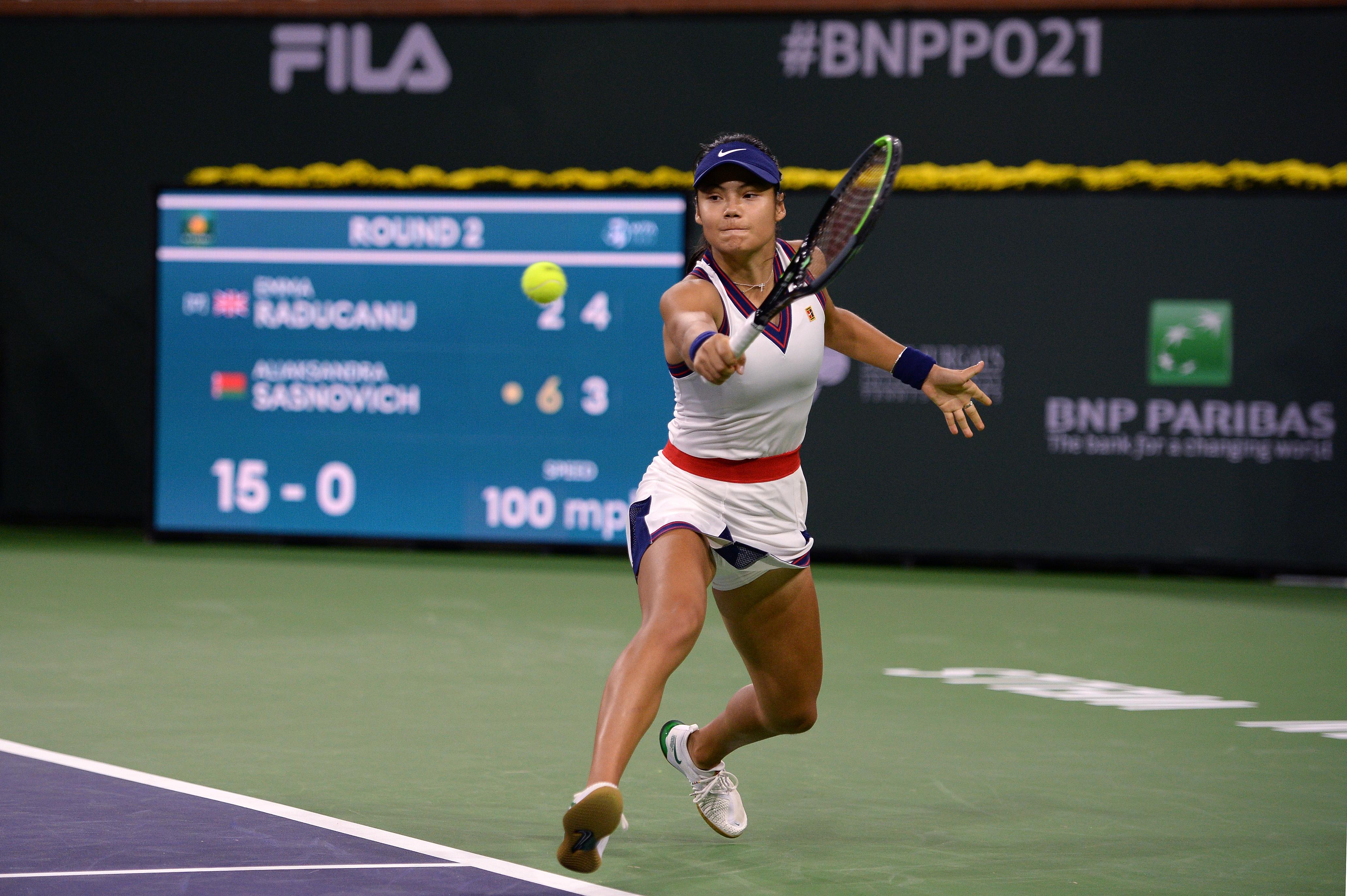 Oct 8, 2021; Indian Wells, CA, USA; Emma Raducanu (GBR) hits a shot against Aliaksandra Sasnovich (BLR) at Indian Wells Tennis Garden. Mandatory Credit: Orlando Ramirez-USA TODAY Sports