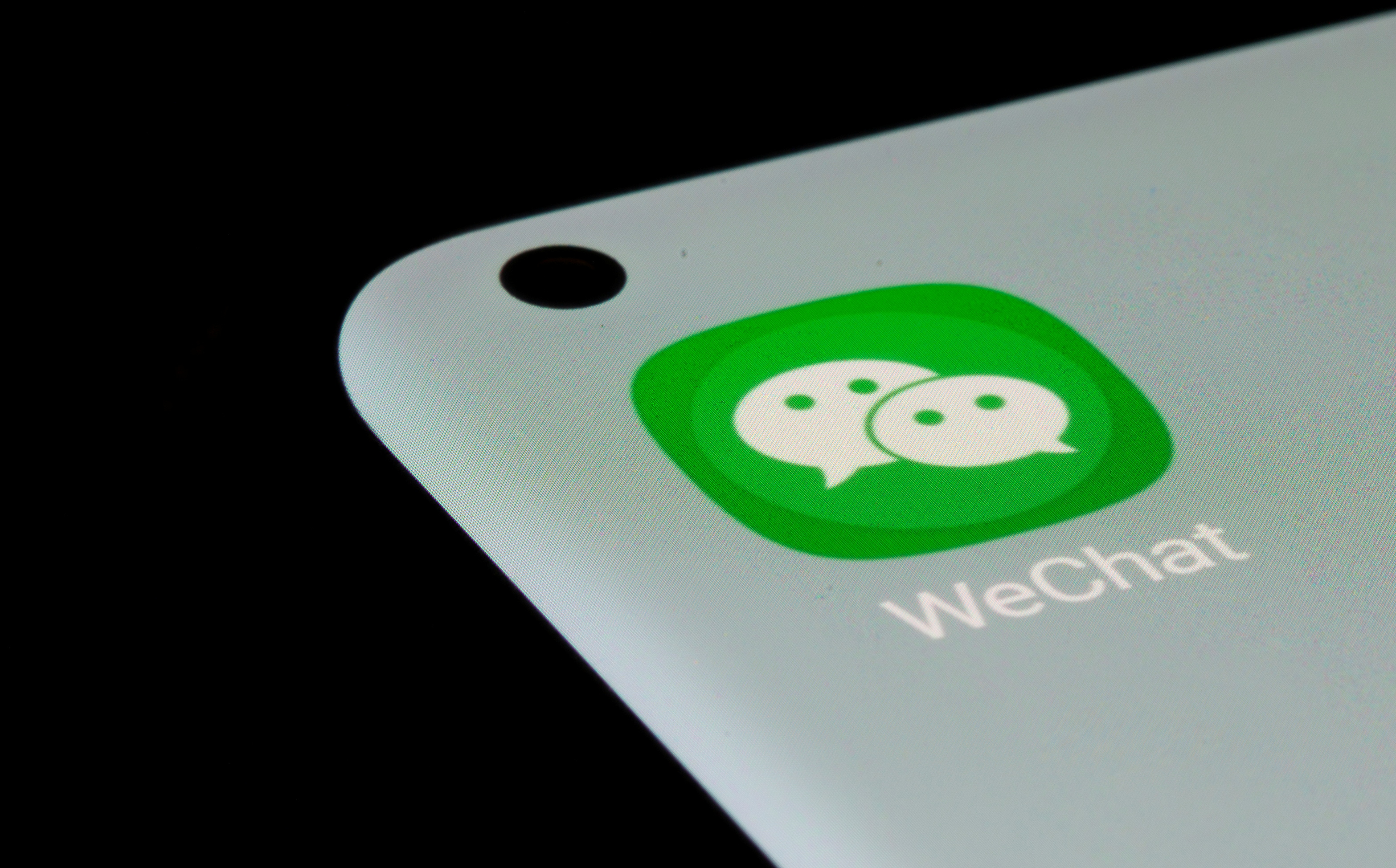 WeChat app is seen on a smartphone in this illustration taken, July 13, 2021. REUTERS/Dado Ruvic/Illustration