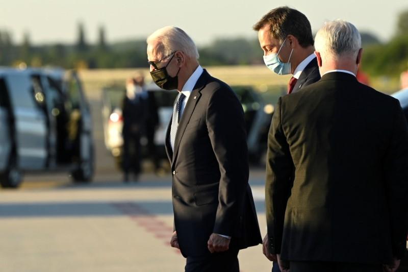 Belgium's Prime Minister Alexander De Croo welcomes U.S. President Joe Biden as he arrives ahead of a NATO summit, at Brussels Military Airport in Melsbroek, Belgium June 13, 2021. Didier Lebrun/Pool via REUTERS
