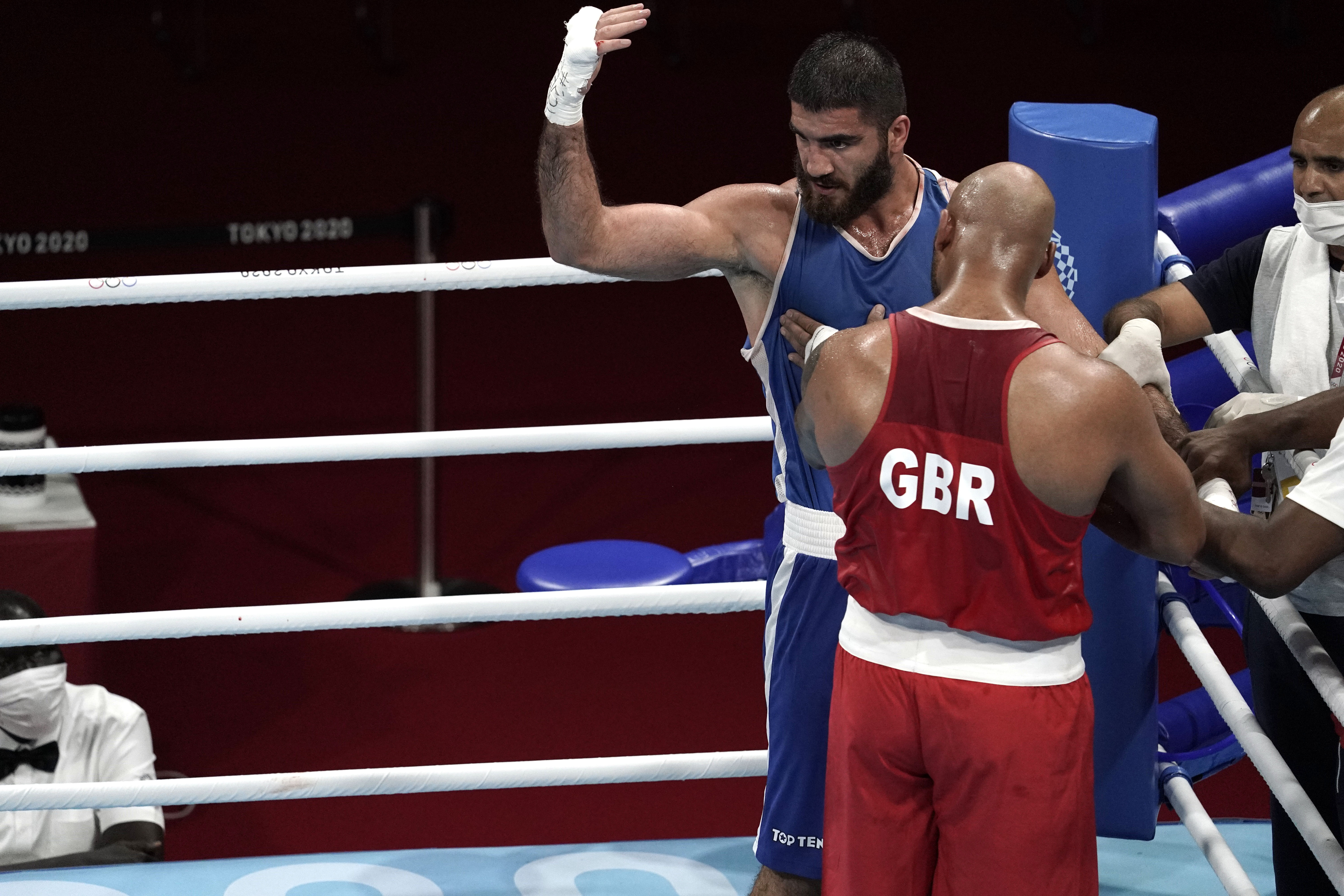 Aug 1, 2021; Tokyo, Japan; Mourad Aliev (FRA), blue shorts, yells at officials after being disqualified in his men's super heavy quarterfinal bout against Frazer Clarke (GBR), red shorts, during the Tokyo 2020 Olympic Summer Games at Kokugikan Arena. Mandatory Credit: Andrew P. Scott-USA TODAY Sports