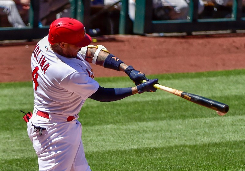 Jun 16, 2021; St. Louis, Missouri, USA;  St. Louis Cardinals catcher Yadier Molina (4) hits a walk-off one run single during the ninth inning against the Miami Marlins  at Busch Stadium. Mandatory Credit: Jeff Curry-USA TODAY Sports