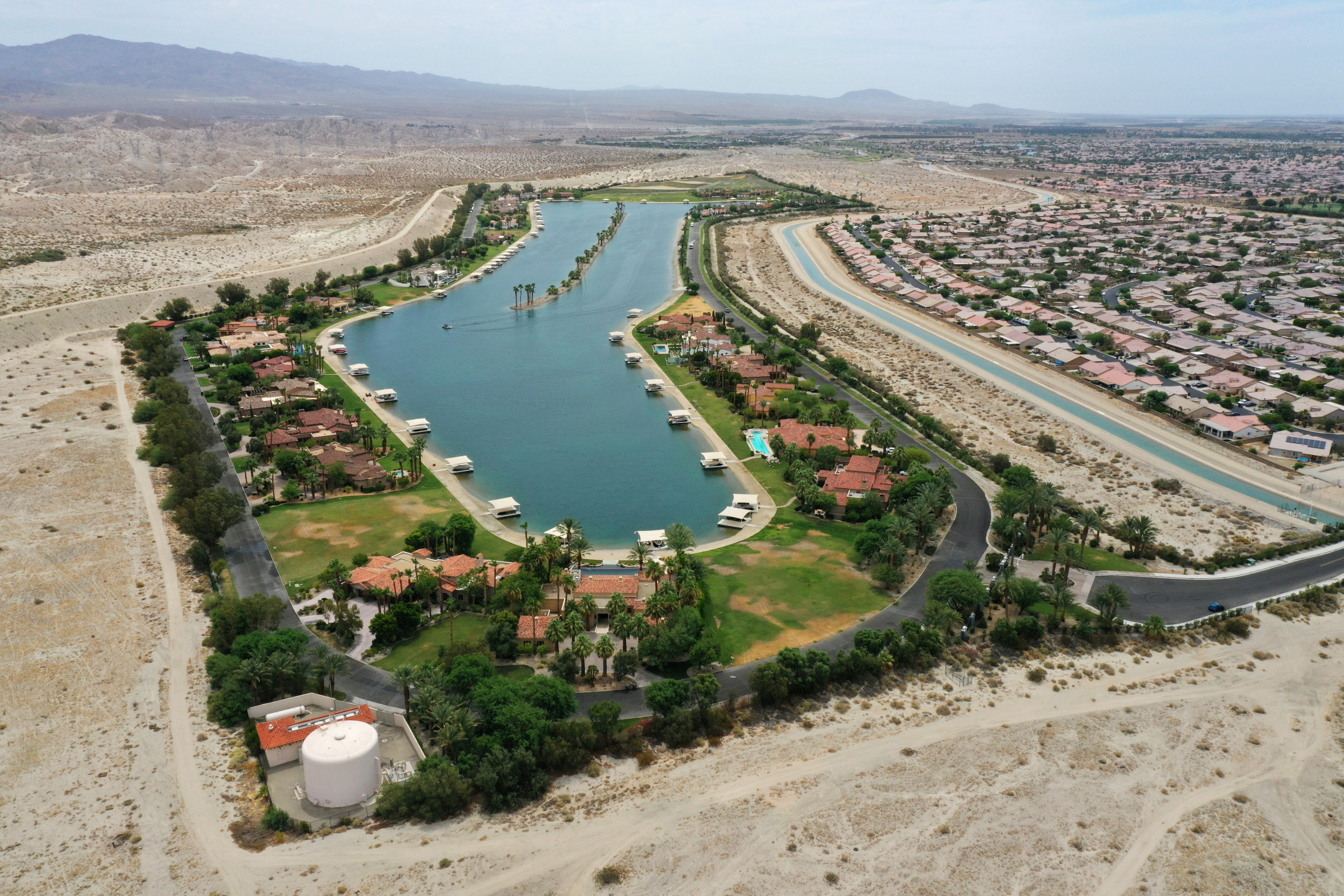 An aerial view shows the artificial lake, Shadow Lake Estates, next to desert landscape as the state faces its worst drought since 1977, in Indio, California June 29, 2021. REUTERS/Aude Guerrucci/File Photo