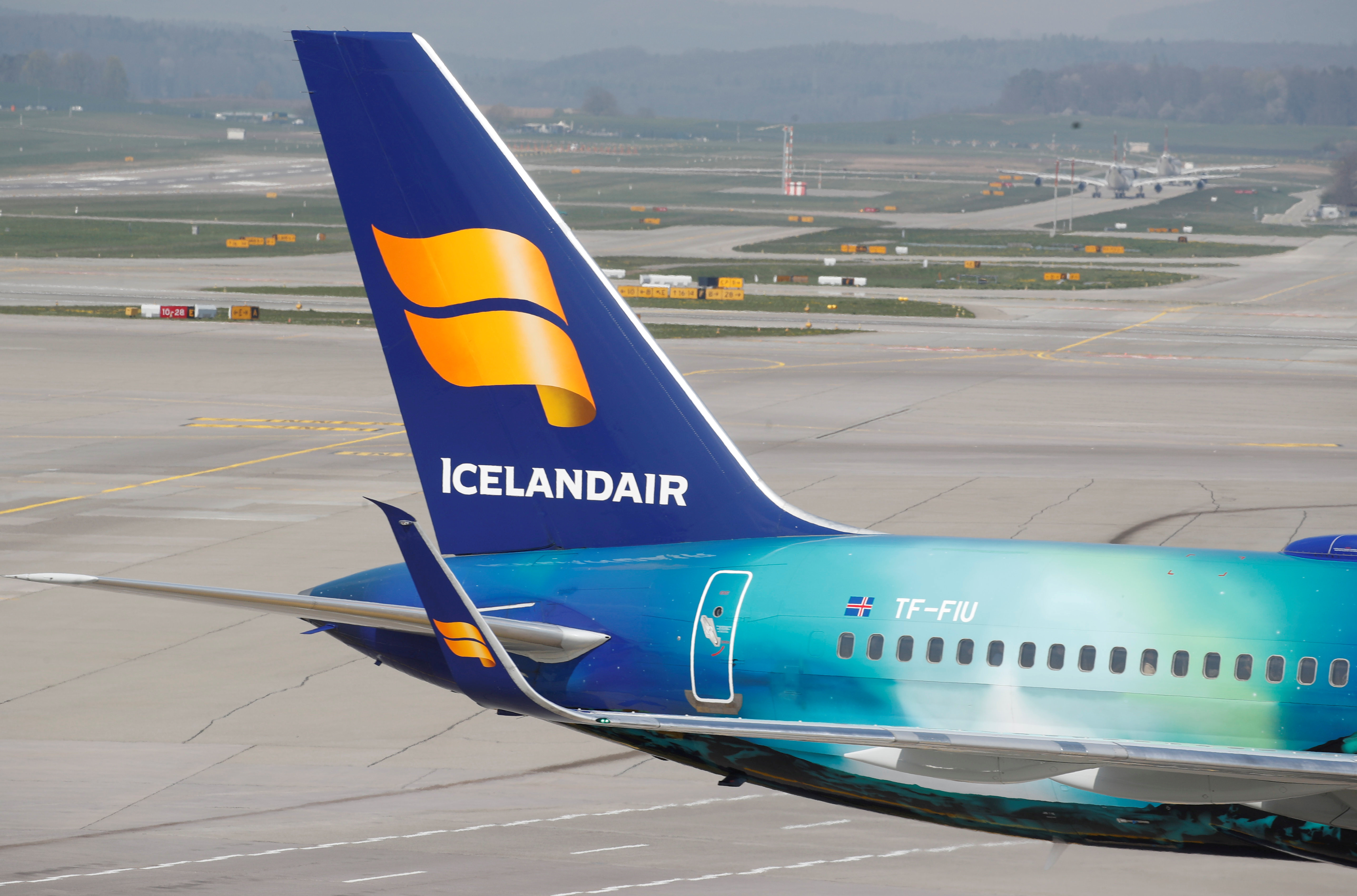 The logo of Icelandair airlines is seen at the tail fin of a Boeing 757-256 aircraft at Zurich airport, Switzerland April 16, 2019. REUTERS/Arnd Wiegmann/File Photo
