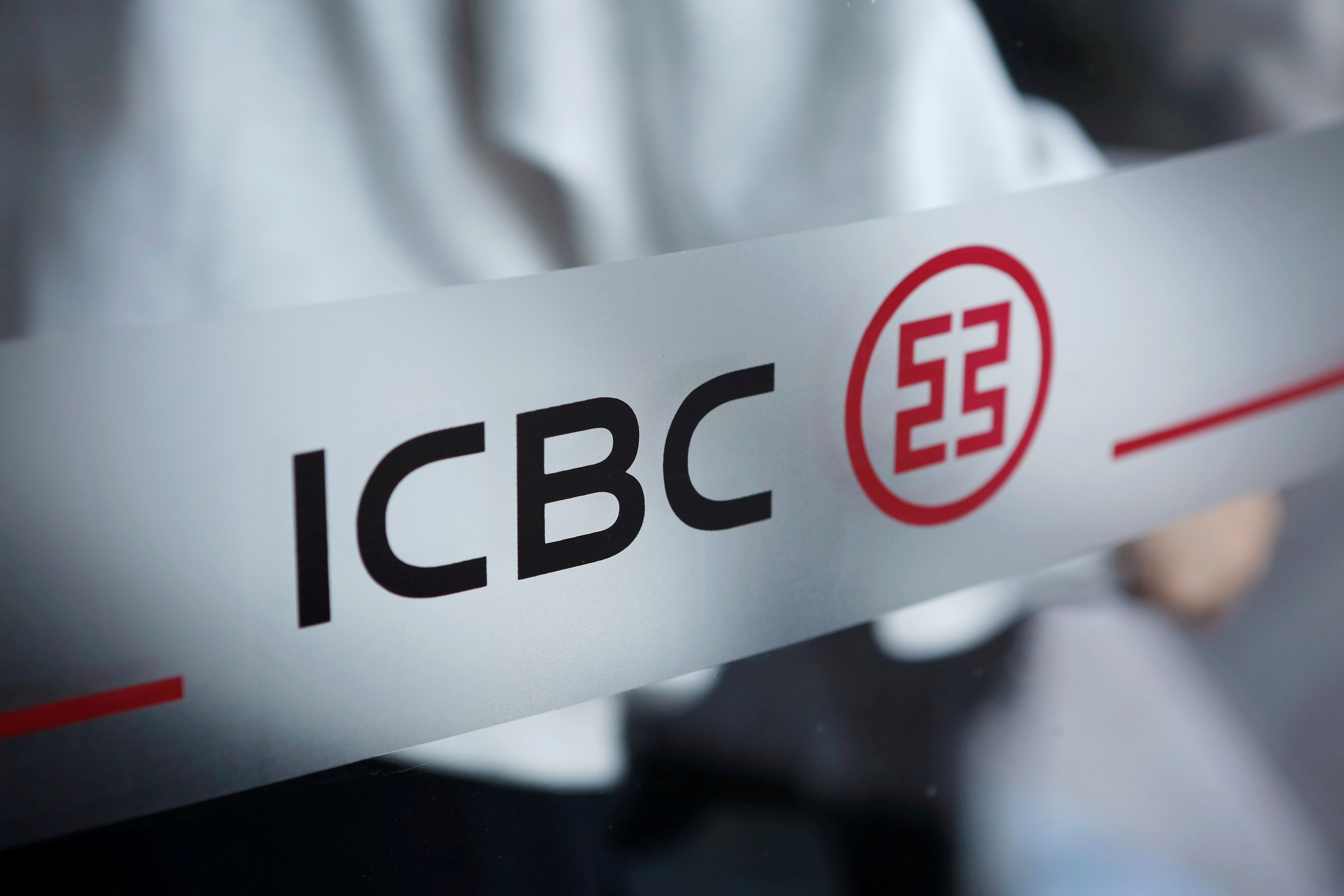 The logo of Industrial and Commercial Bank of China (ICBC) is pictured at the entrance to its branch in Beijing, China April 1, 2019.    REUTERS/Florence Lo/File Photo