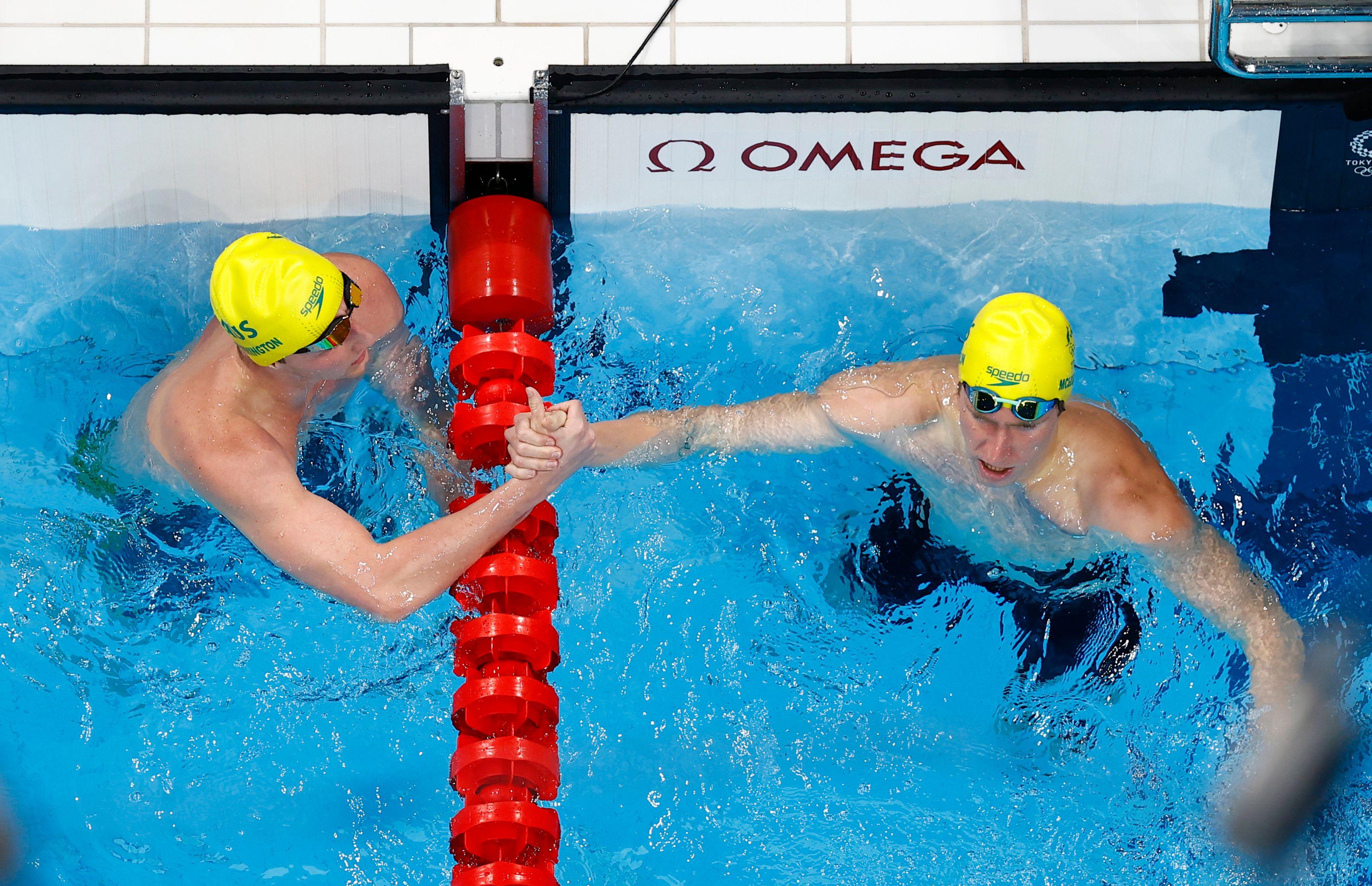 Tokyo 2020 Olympics - Swimming - Men's 400m Freestyle - Heats - Tokyo Aquatics Centre - Tokyo, Japan - July 24, 2021. Elijah Winnington of Australia and Jack McLoughlin of Australia react REUTERS/Antonio Bronic